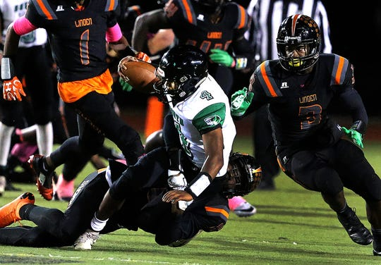 South Plainfield quarterback Samual Nieves runs against Linden during the first half Friday, Oct. 12, 2018.