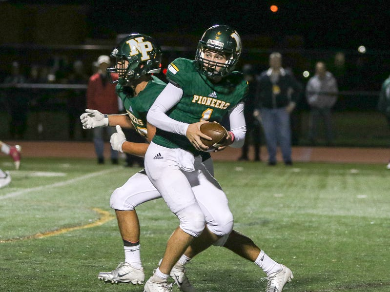 New Providence quarterback Owen Kovacs (1) tossed three touchdown passes and ran in another against Brearley on Friday, Oct. 12, 2018.
