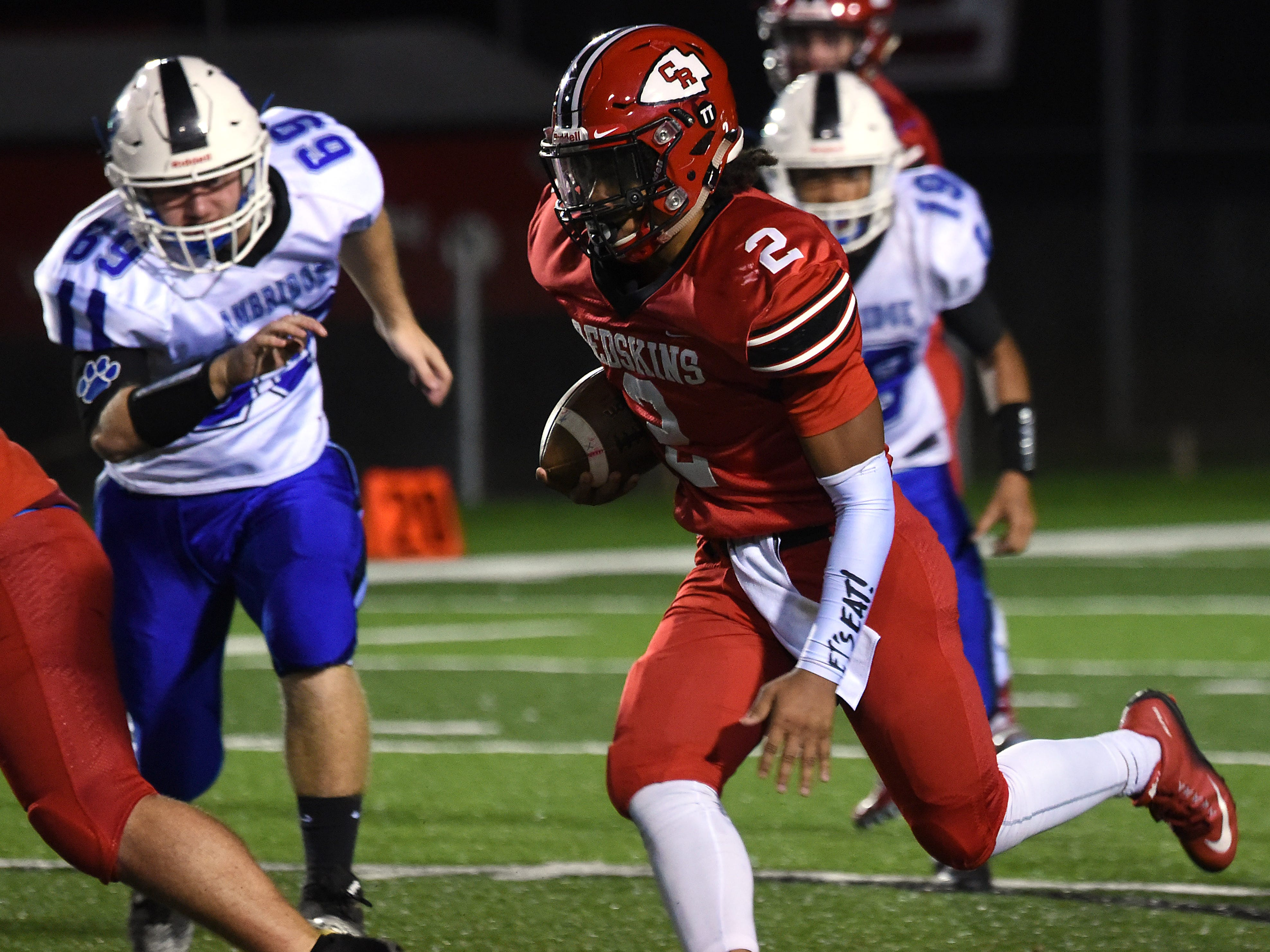 Coshocton junior Cameron Johns carries the ball during their homecoming game on Friday, Oct. 12, 2018. Coshocton lost 33-22.