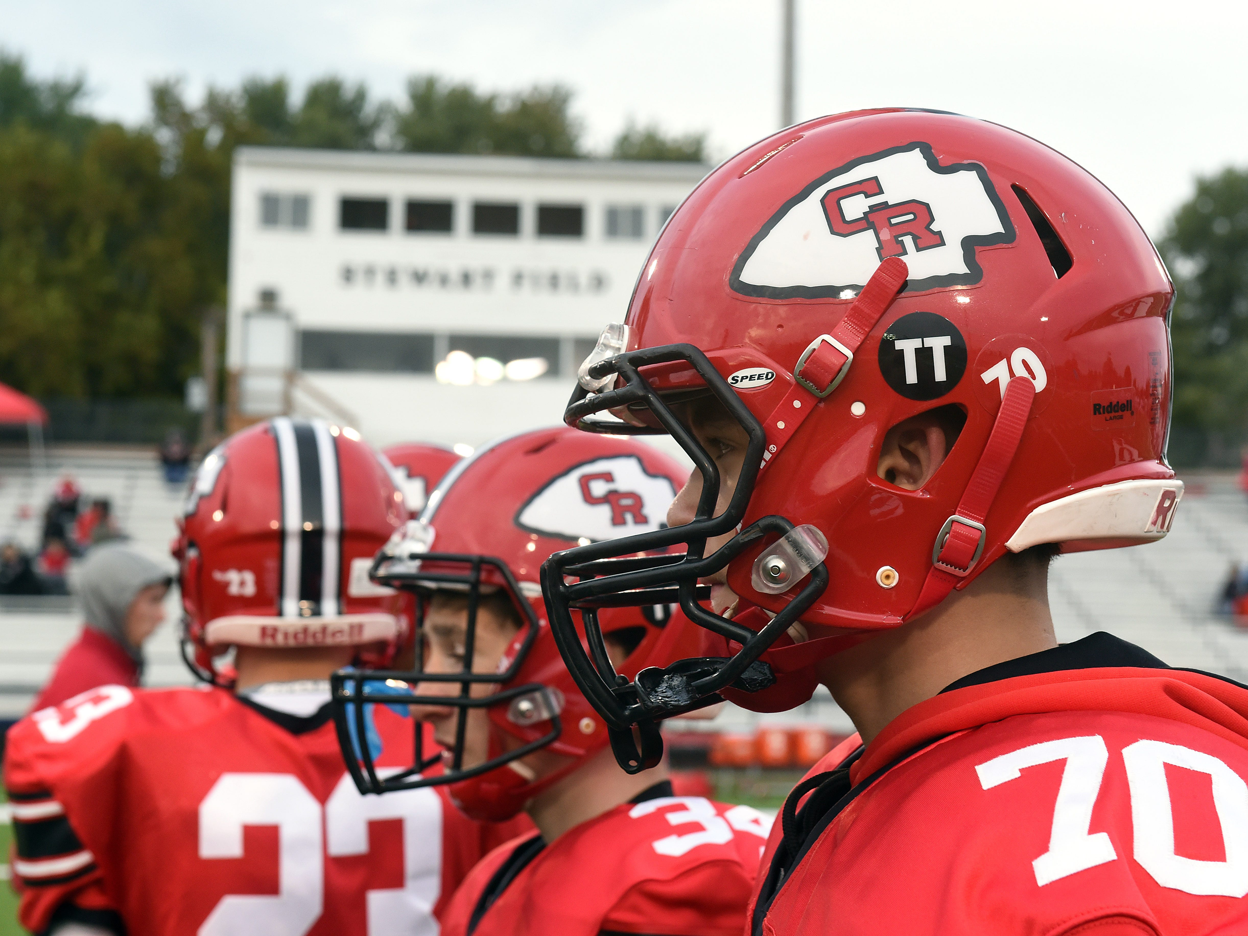 """Coshocton football players added """"TT"""" stickers to their helmets in memory of WTNS radio's Tom Thompson, who lost his battle with cancer on Oct. 6. Thompson covered local sports through his 45 years with the station."""
