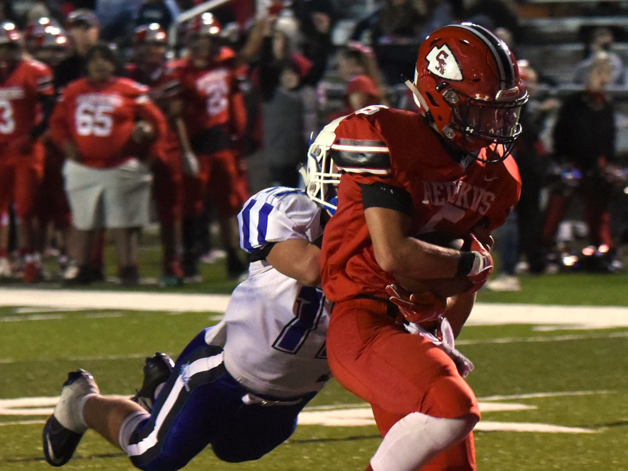 Coshocton senior Andrew Kittell makes it in to the end zone before a Cambridge defender can tackle him for a touchdown in the second quarter during their homecoming game on Friday, Oct. 12, 2018. Coshocton lost 33-22.