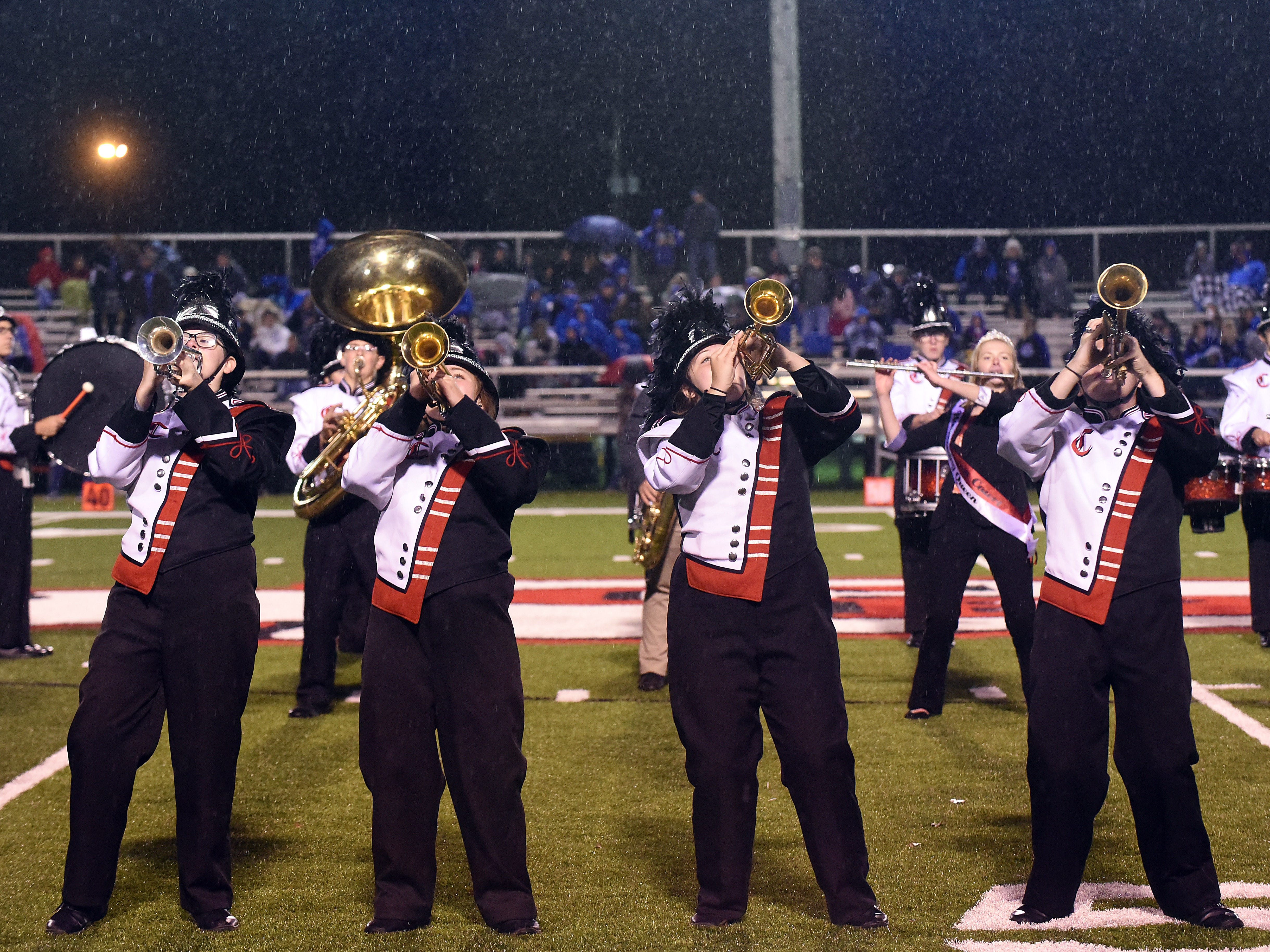The Coshocton marching band performs during a rainy halftime on Friday, Oct. 12, 2018.