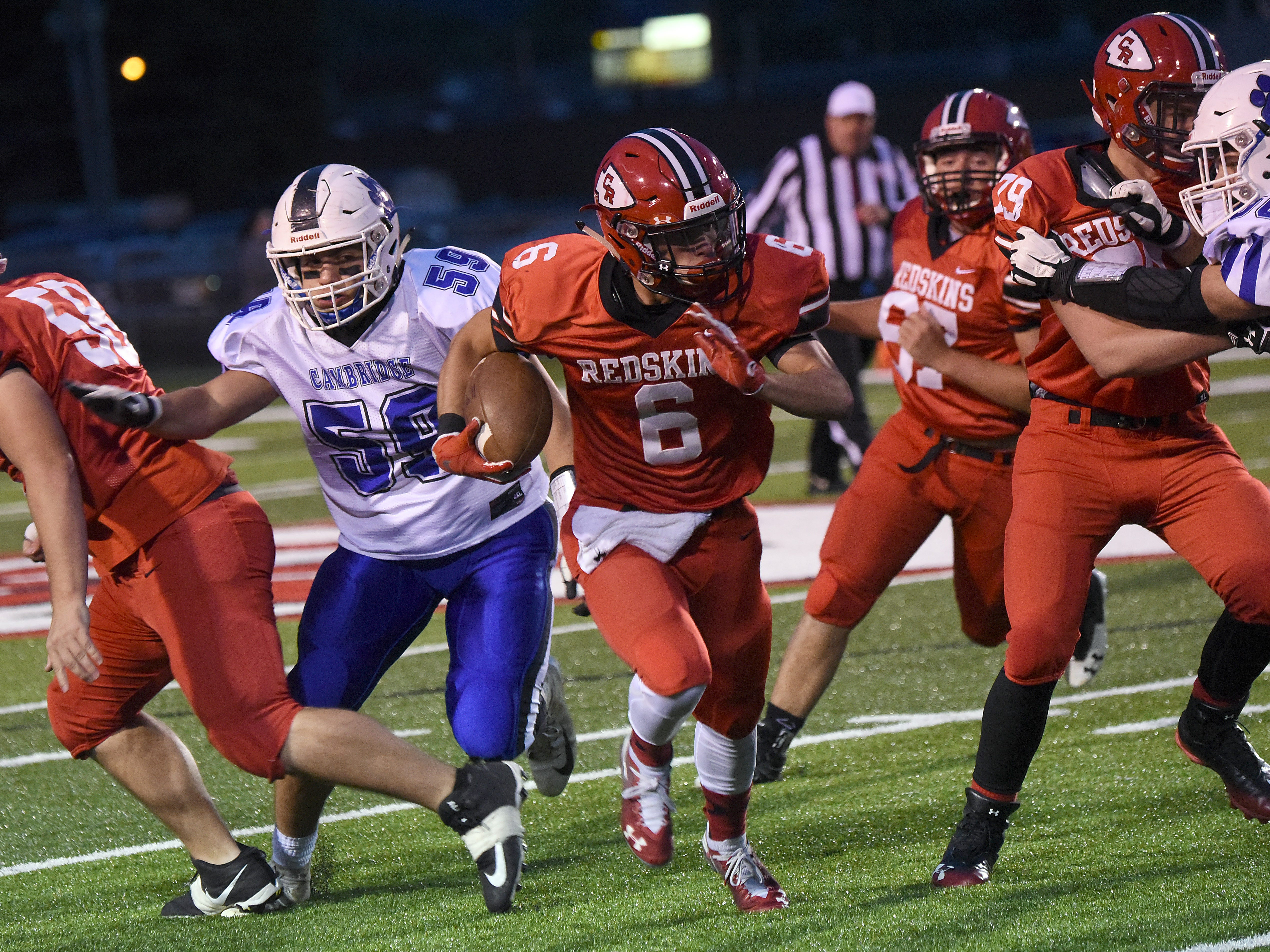 Coshocton senior Andrew Kittelll finds an opening in the Cambridge defense during their homecoming game on Friday, Oct. 12, 2018. Coshocton lost 33-22.