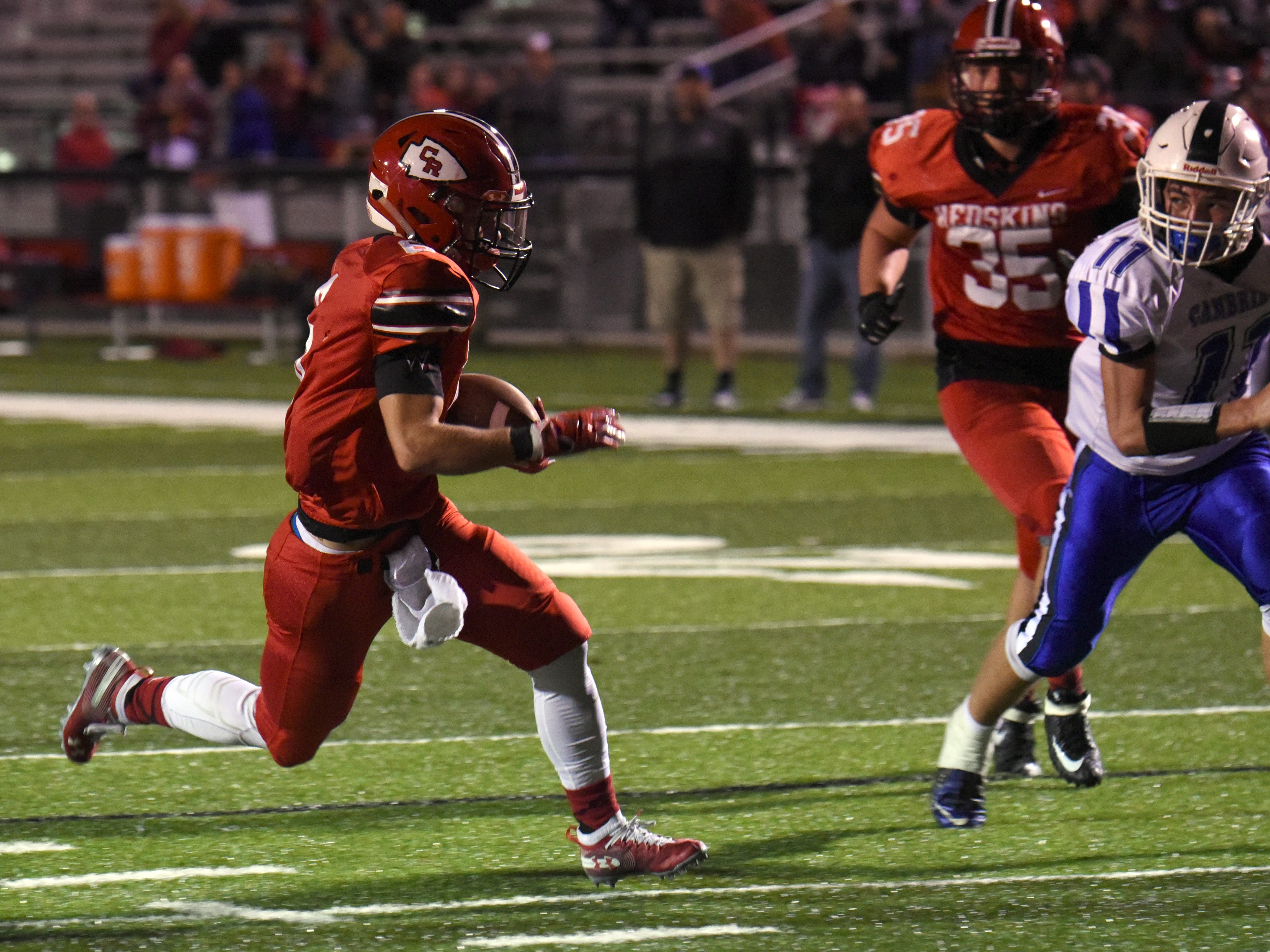 Coshocton senior Andrew Kittell carries the ball for a touchdown in the second quarter against Cambridge during their homecoming game on Friday, Oct. 12, 2018. Coshocton lost 33-22.