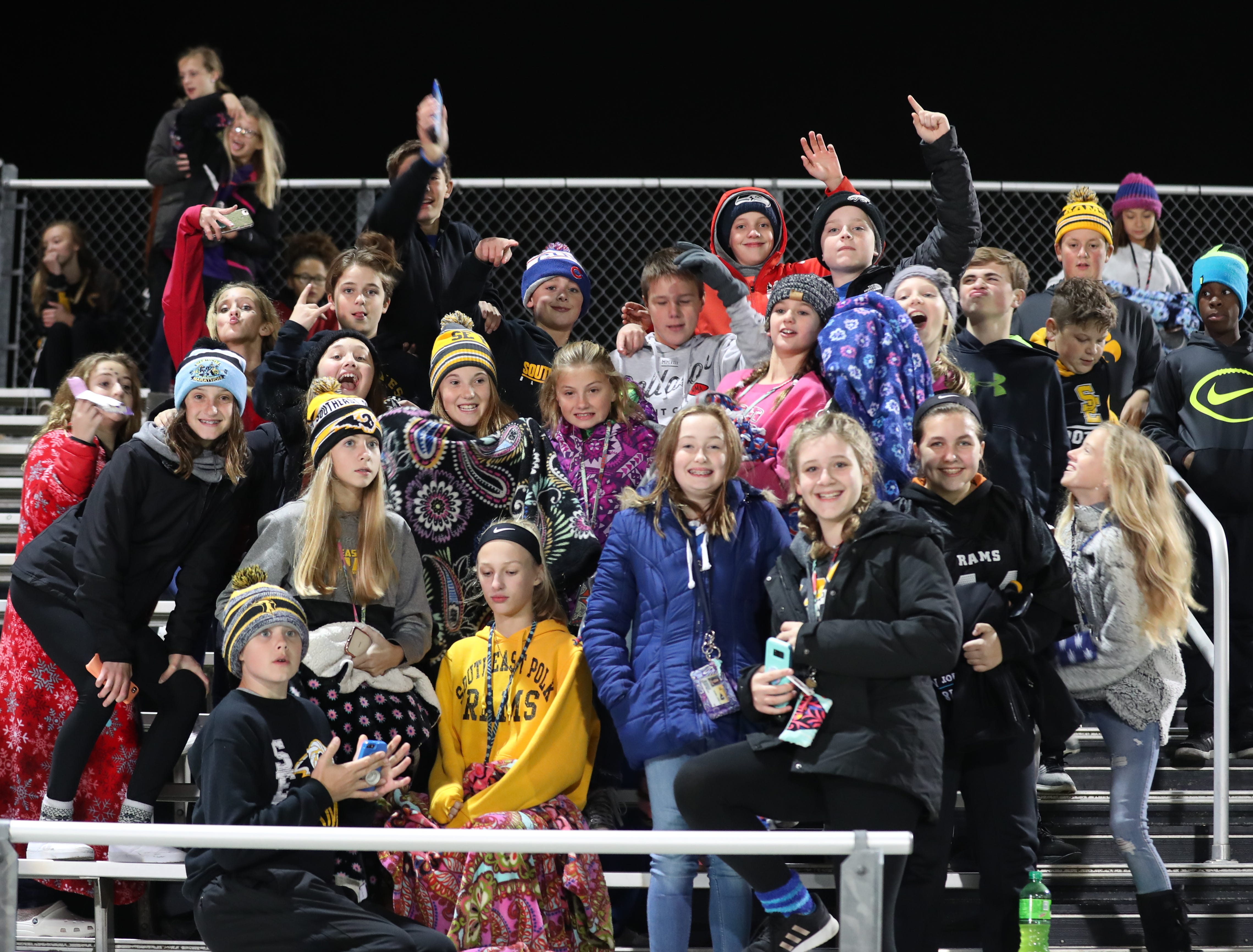 Southeast Polk Rams Jr. High students having a good time at their football game against the Marshalltown Bobcats at SE Polk Stadium. The Rams beat the Bobcats 56 to 7.