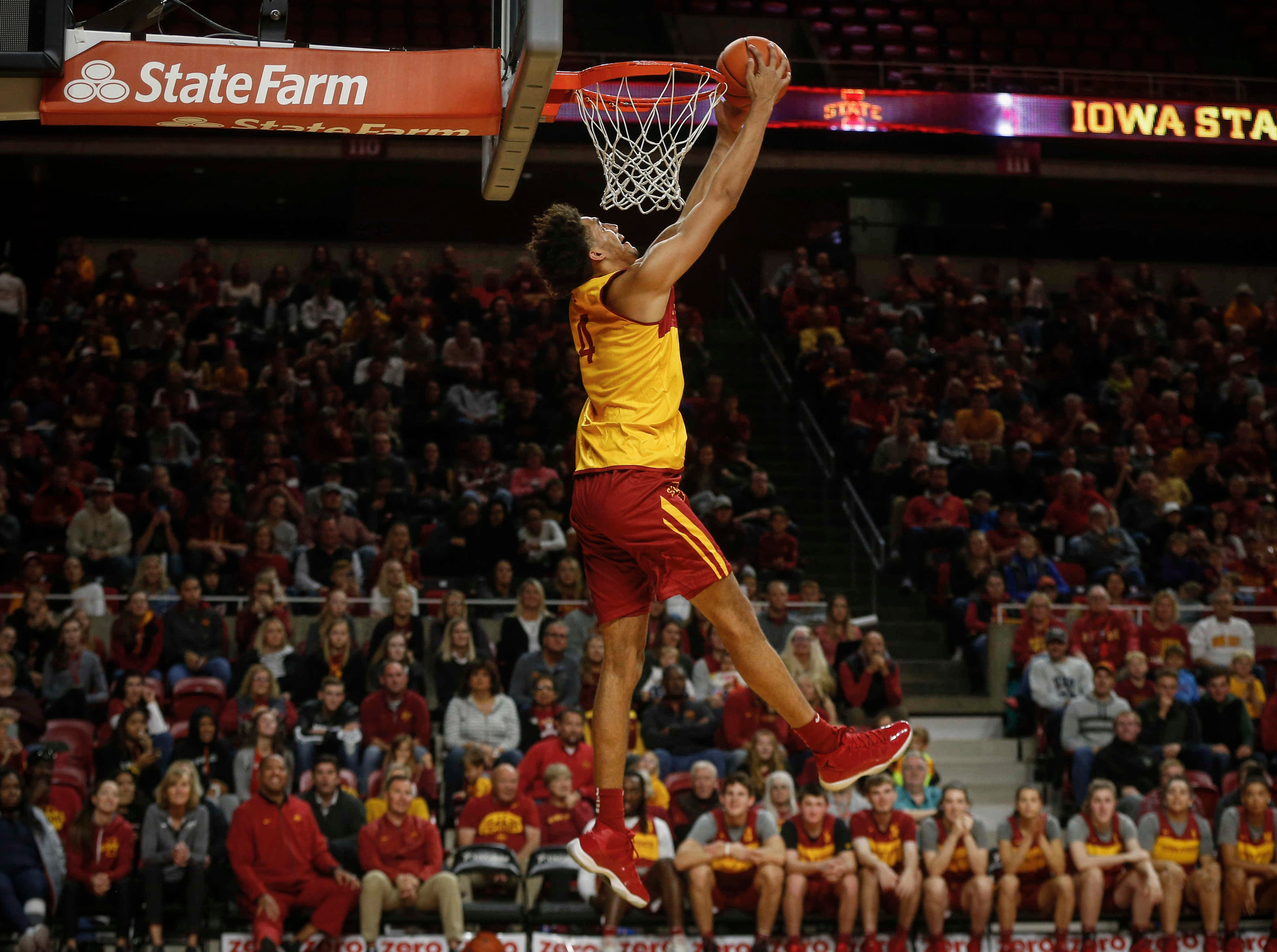 George Conditt IV dunks the ball during warmups during Hilton Madness at Hilton Coliseum in Ames on Friday, Oct. 12, 2018.
