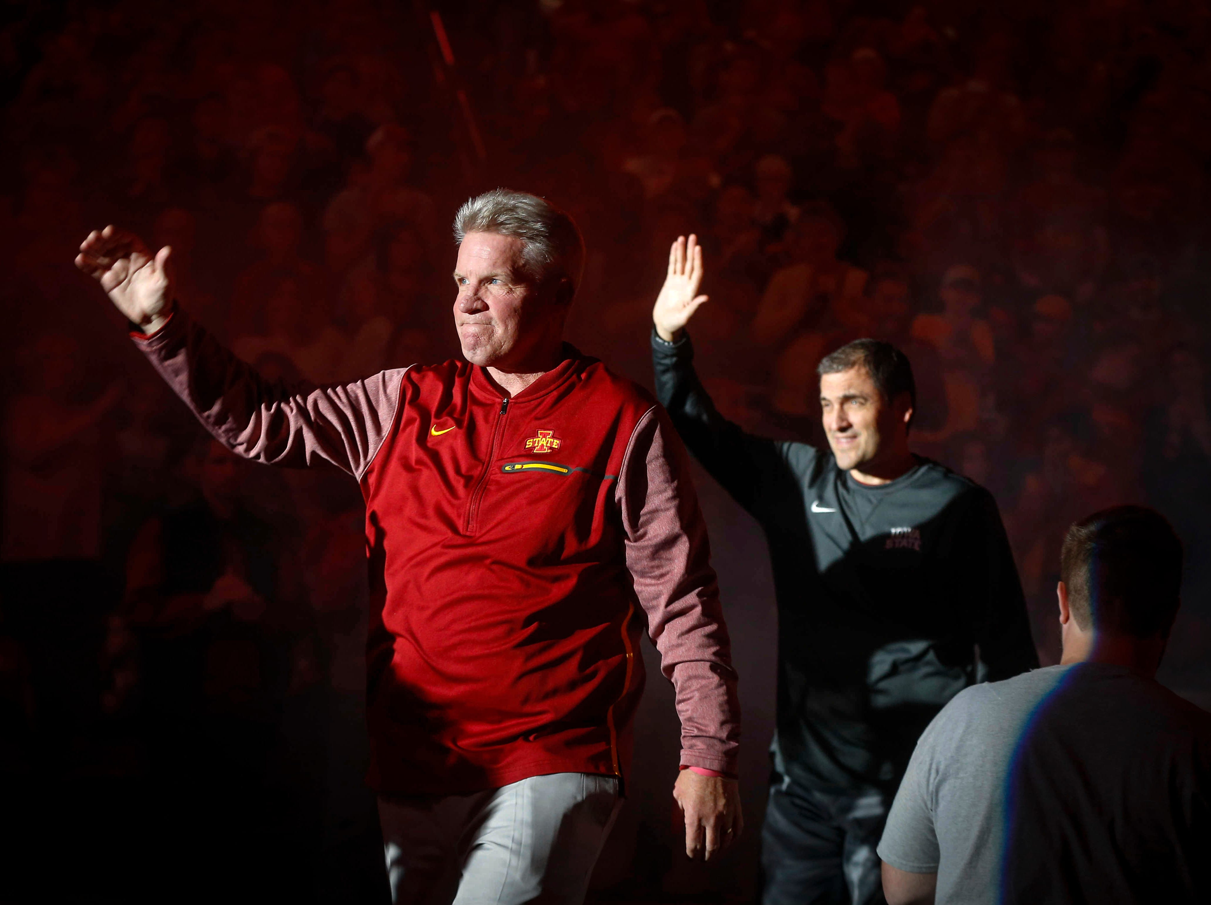 Iowa State women's head basketball coach Bill Fennelly waves to the crowd as he is introduced during Hilton Madness at Hilton Coliseum in Ames on Friday, Oct. 12, 2018.