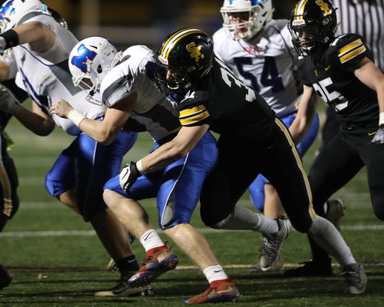 Southeast Polk Rams Carter Olesen (31) makes the tackle against the Marshalltown Bobcats at SE Polk Stadium. The Rams beat the Bobcats 56 to 7.