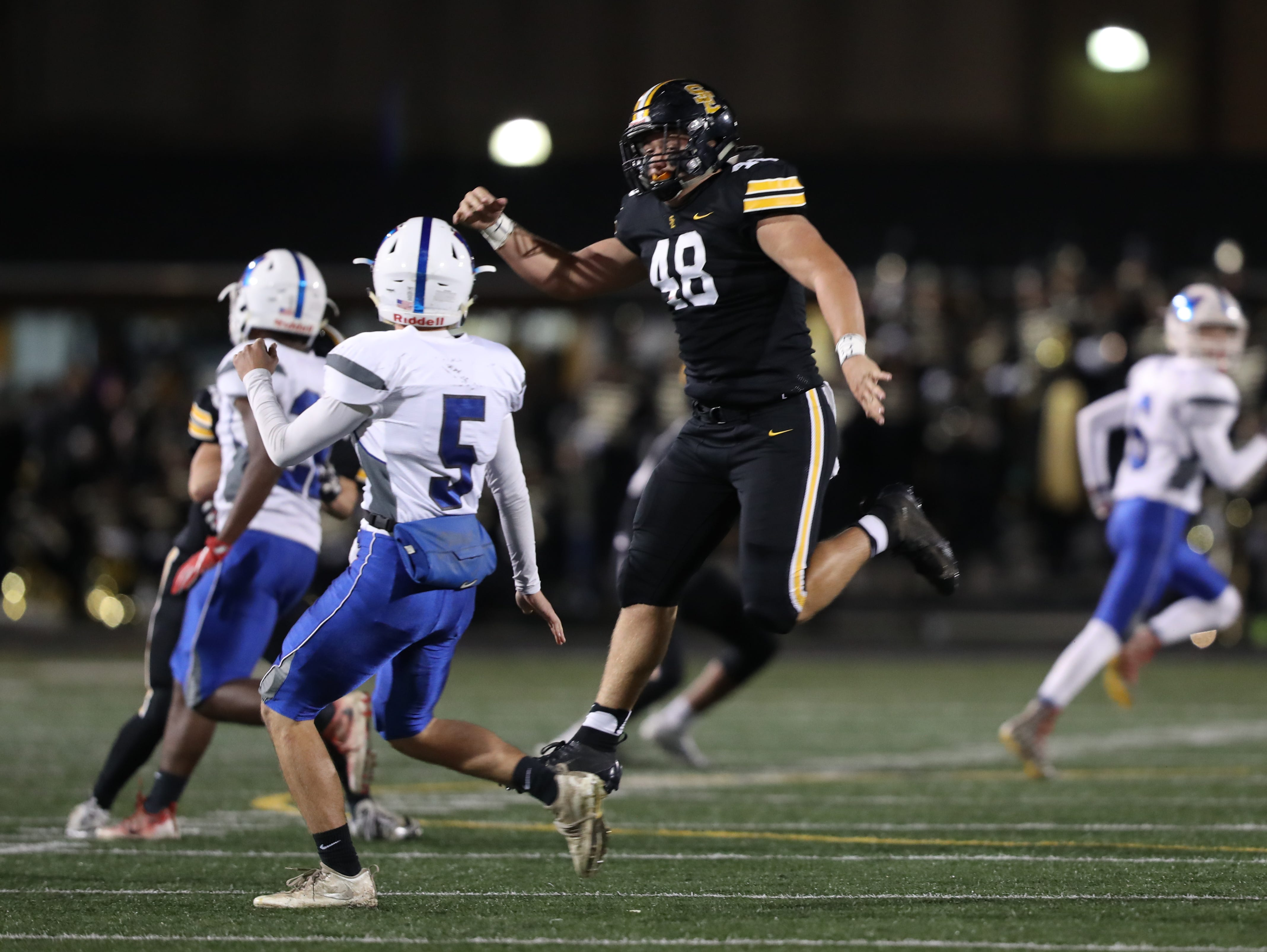 Southeast Polk Rams Bo Ira (48) pressures the QB against the Marshalltown Bobcats at SE Polk Stadium. The Rams beat the Bobcats 56 to 7.