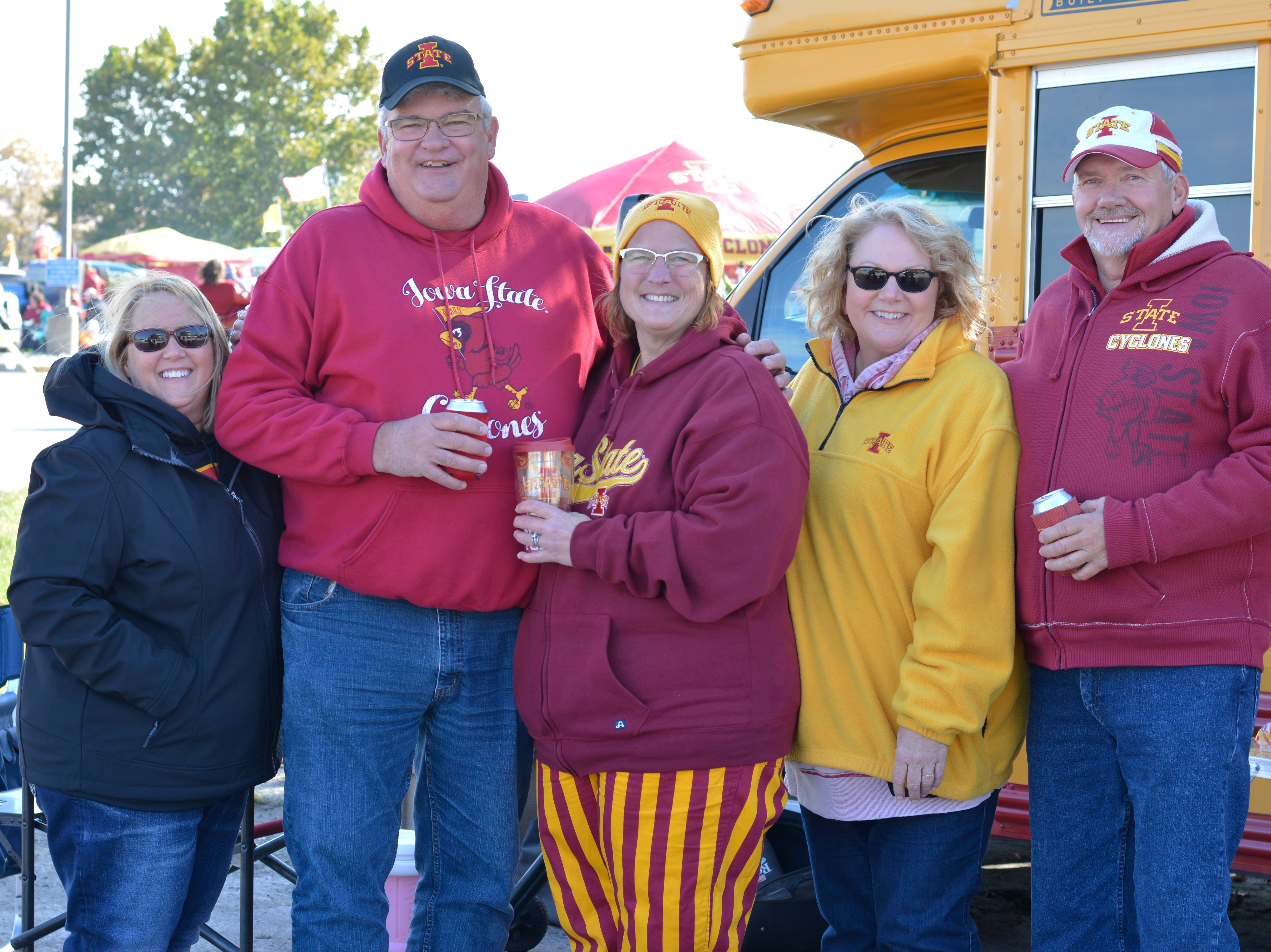 DeAnn Scharingson (from left) Bruce Uthe, Michelle Uthe, Dee Savits and Jon Savits before the Iowa State University football game against West Virginia in Ames on Oct. 13.