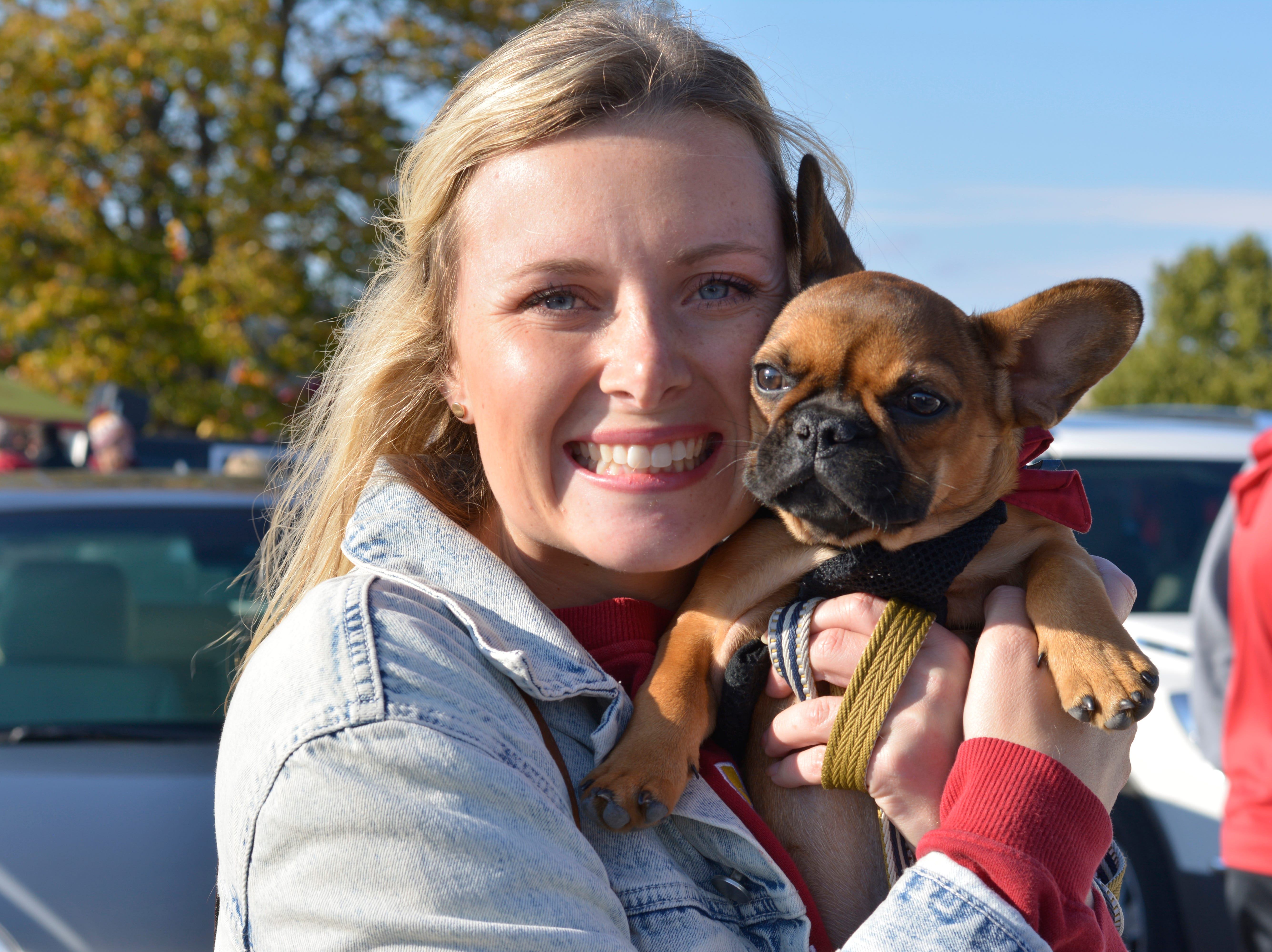 Cassidy Longnecker and her dog Milo before the Iowa State University football game against West Virginia in Ames on Oct. 13.