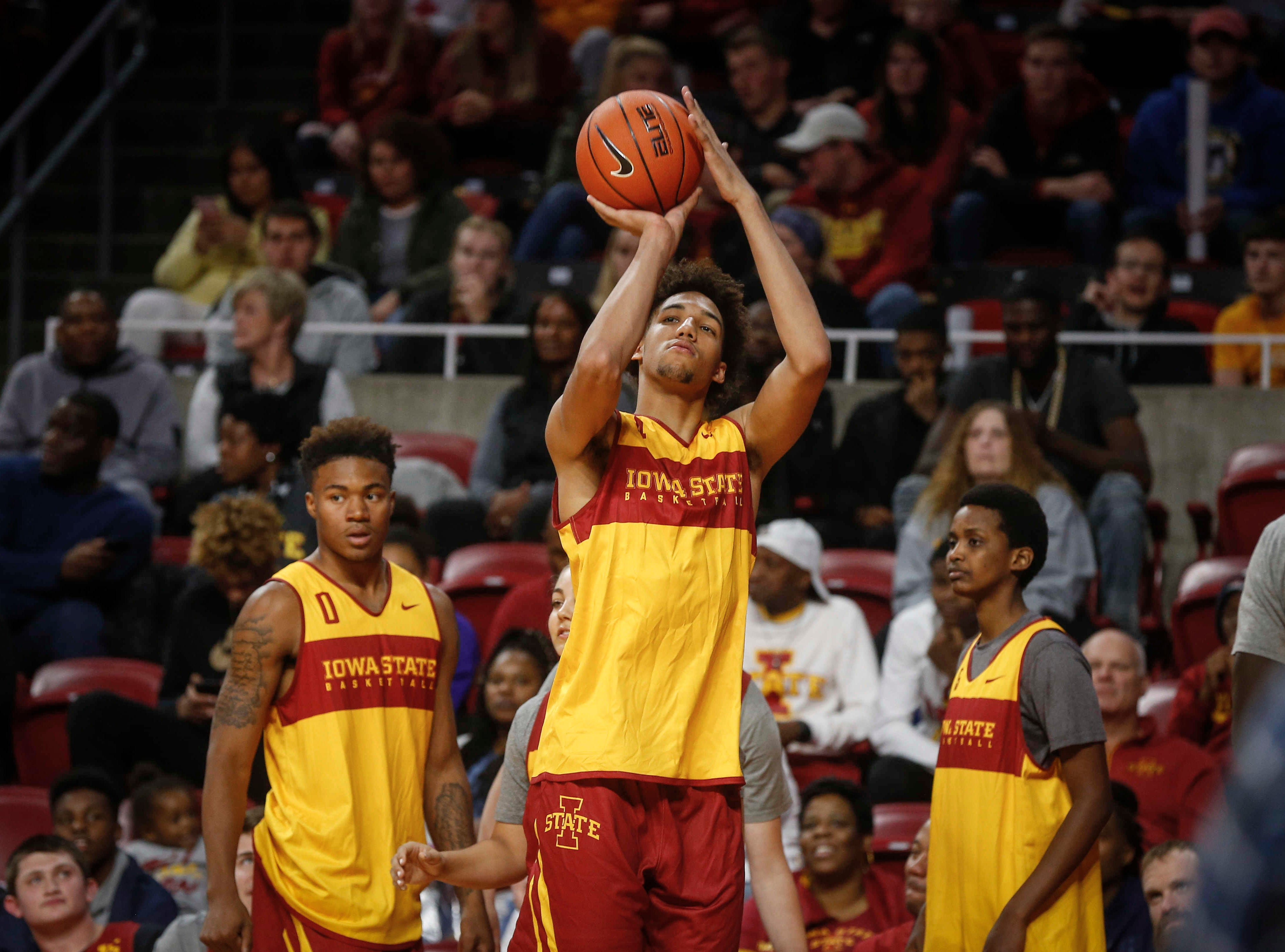 George Conditt IV lines up a shot from behind the three point line during Hilton Madness at Hilton Coliseum in Ames on Friday, Oct. 12, 2018.
