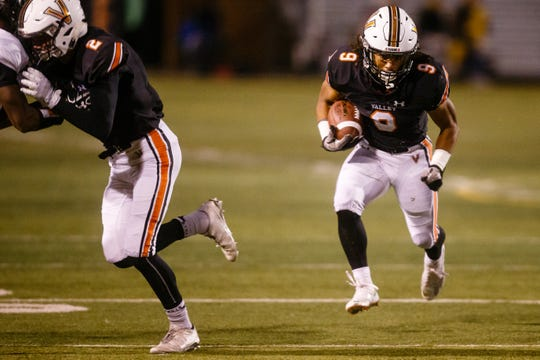 Valley's Creighton Mitchell (9) rushes during their football game against Ames at Valley Stadium on Friday, Oct. 12, 2018, in West Des Moines. Valley takes a 31-0 lead into halftime.