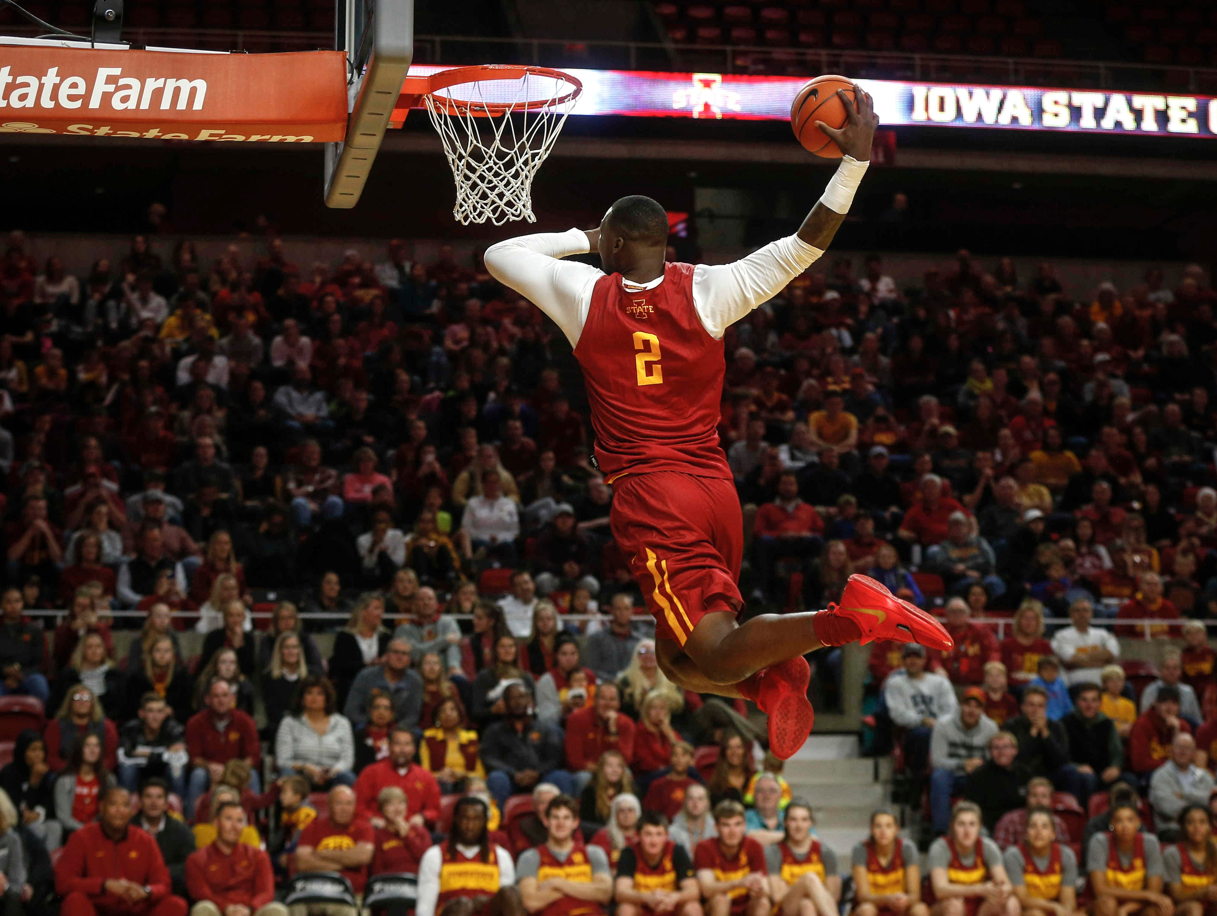 Iowa State's Cameron Lard dabs as he dunks the ball during the slam dunk competition during Hilton Madness at Hilton Coliseum in Ames on Friday, Oct. 12, 2018.