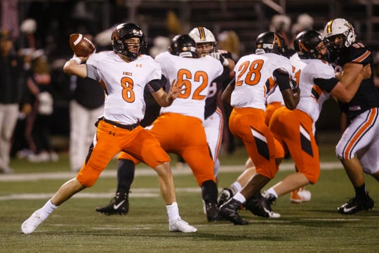 Ames' Cooper Downs (8) passes during their football game at Valley Stadium on Friday, Oct. 12, 2018, in West Des Moines. Valley takes a 31-0 lead into halftime.