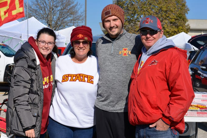 Hannah Caple, (from left) Beth Caple, Nate Brown and Bryce Caple before the Iowa State University football game against West Virginia in Ames on Oct. 13.