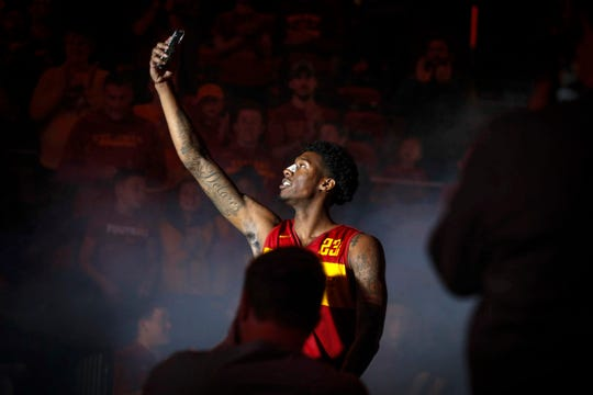 Iowa State's Zoran Talley Jr. takes a selfie as he is introduced during Hilton Madness at Hilton Coliseum in Ames on Friday, Oct. 12, 2018.