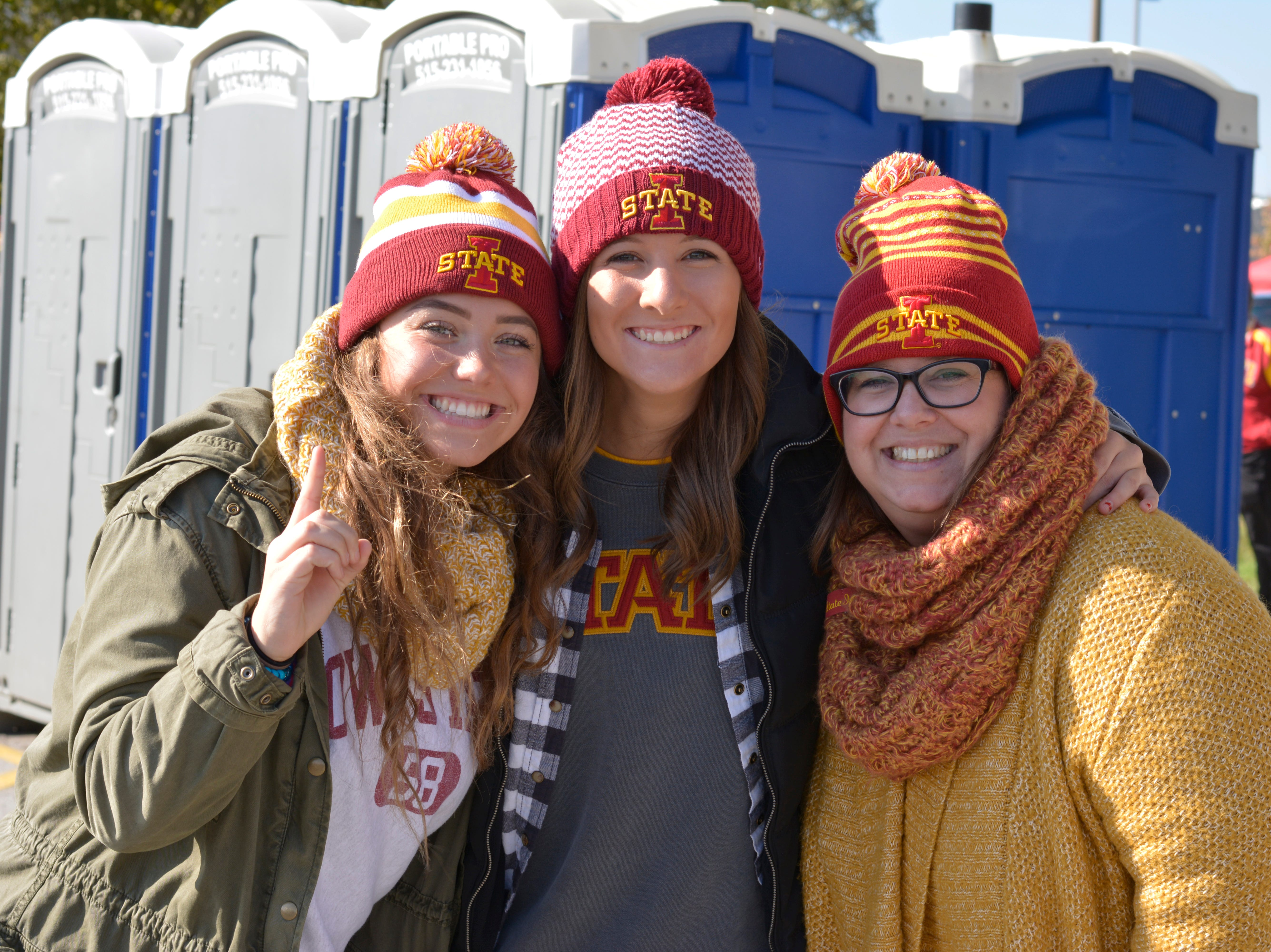 Becca Reece (left), Abi Dimmer (middle) and Stacy Reece (right) before the Iowa State University football game against West Virginia in Ames on Oct. 13.