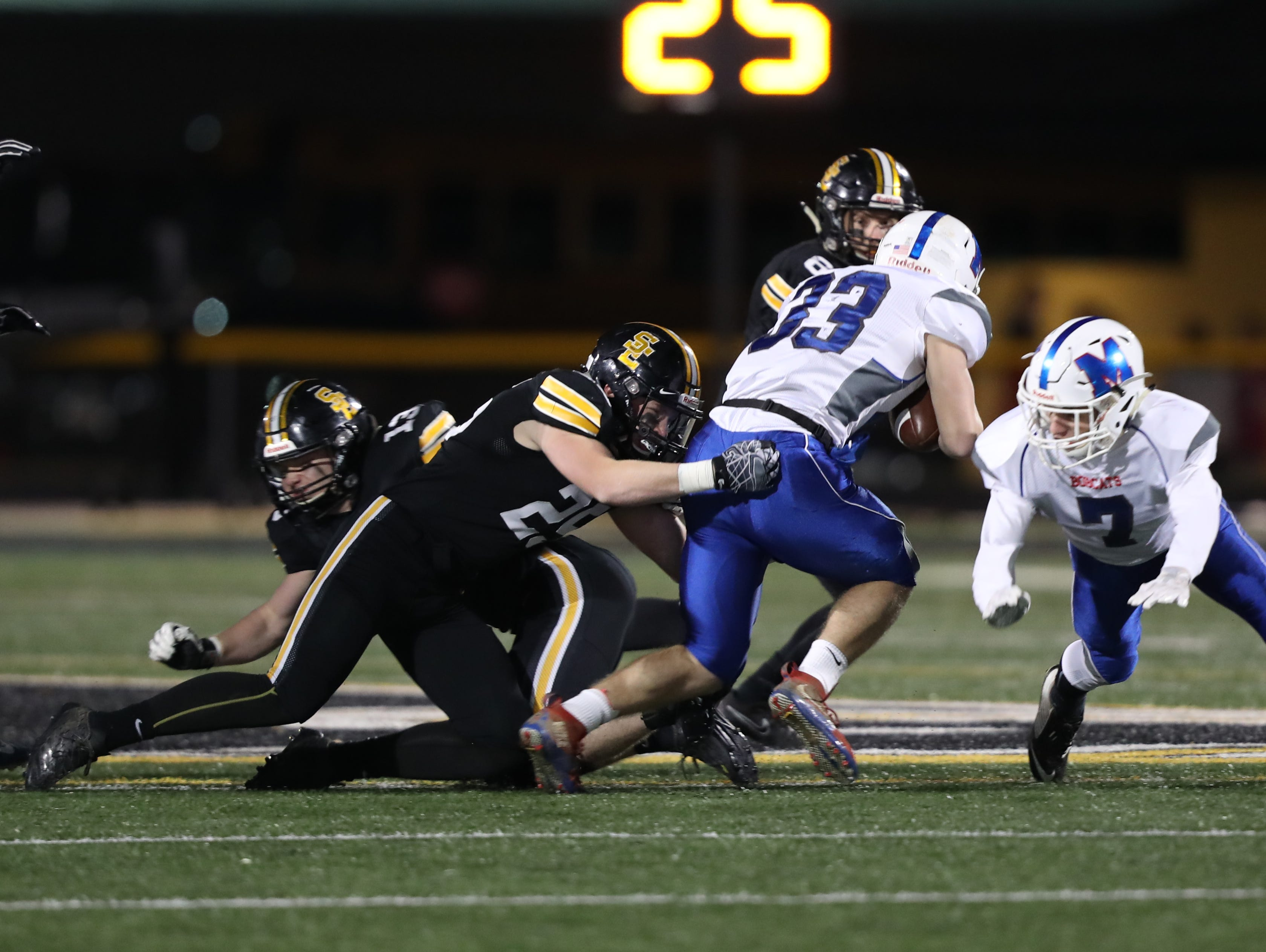 Southeast Polk Rams Zach Strickland (25) makes the tackle against the Marshalltown Bobcats at SE Polk Stadium. The Rams beat the Bobcats 56 to 7.