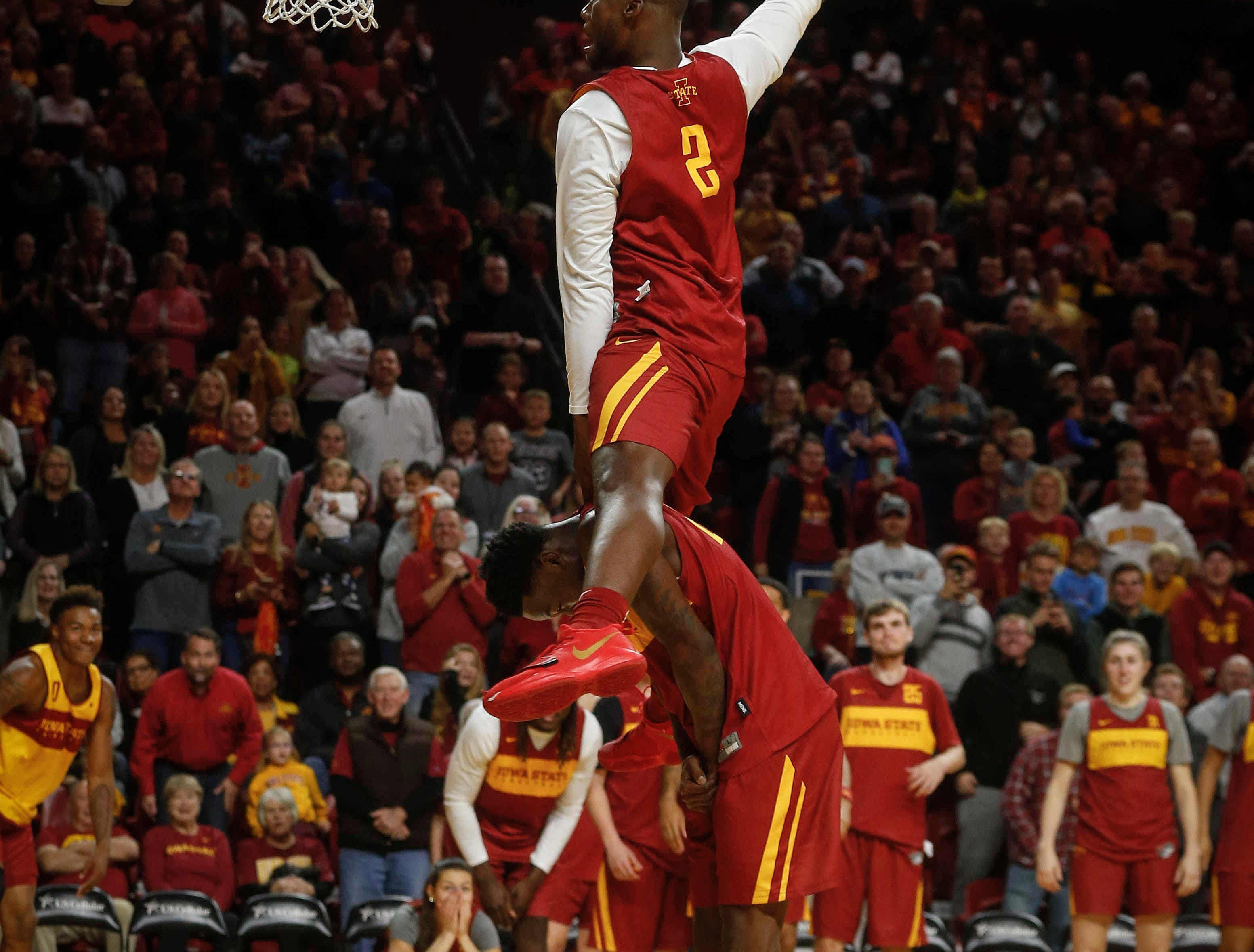 Iowa State's Cameron Lard dunks over a teammate in the slam dunk competition during Hilton Madness at Hilton Coliseum in Ames on Friday, Oct. 12, 2018.