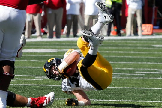 Iowa Hawkeyes defensive back Jake Gervase (30) gets tripped up after intercepting the ball against the Indiana Hoosiers during the fourth quarter at Memorial Stadium.