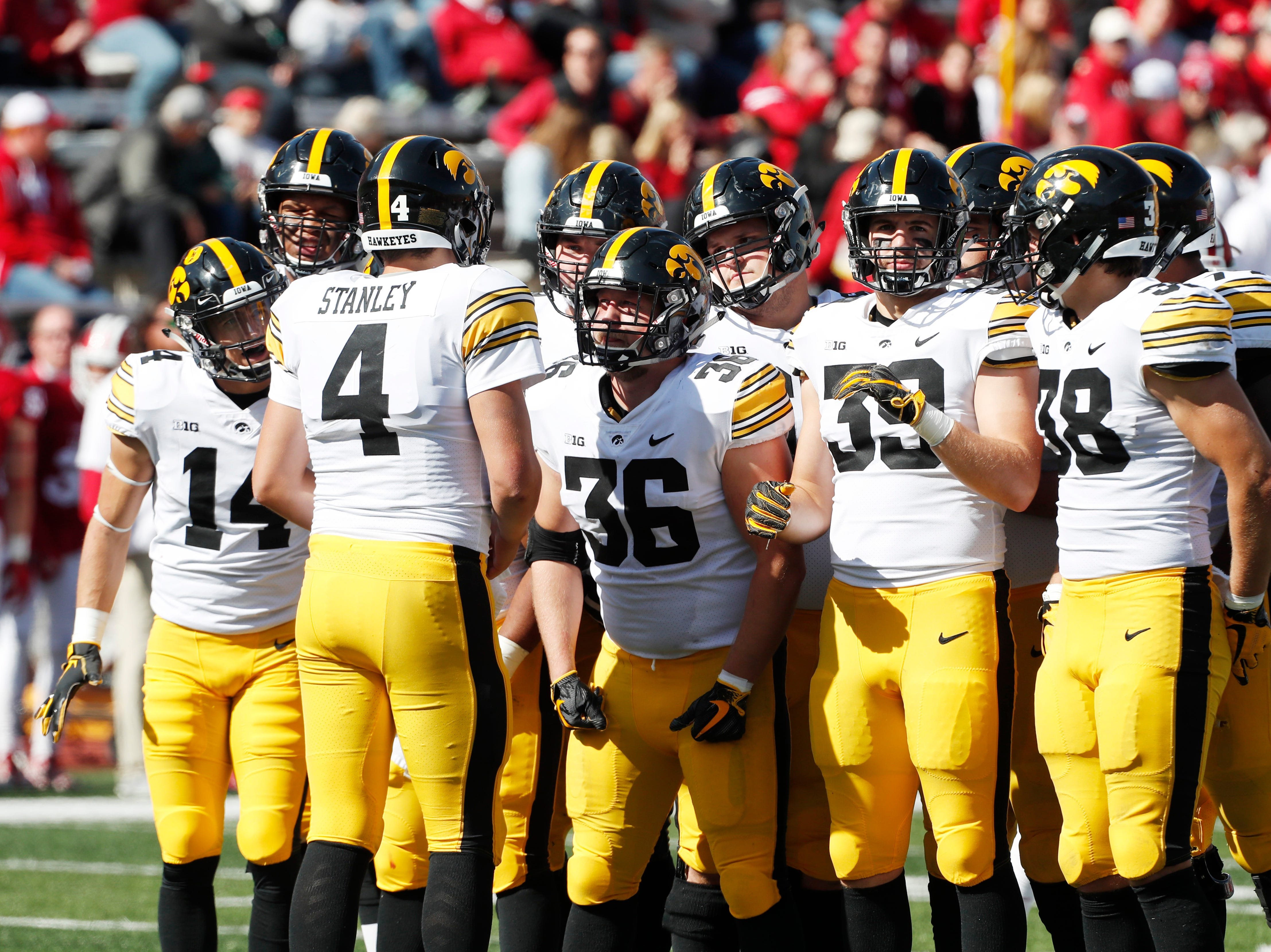 Iowa Hawkeyes quarterback Nate Stanley (4) huddles up with his team against the Indiana Hoosiers during the fourth quarter at Memorial Stadium.