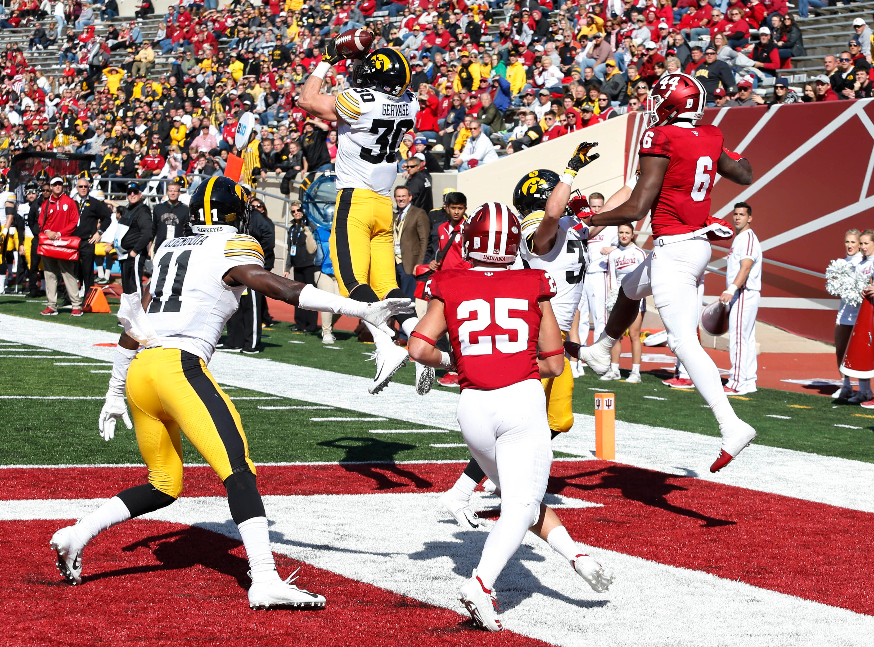 Iowa Hawkeyes defensive back Jake Gervase (30) intercepts the ball in the end zone against the Indiana Hoosiers during the fourth quarter at Memorial Stadium.
