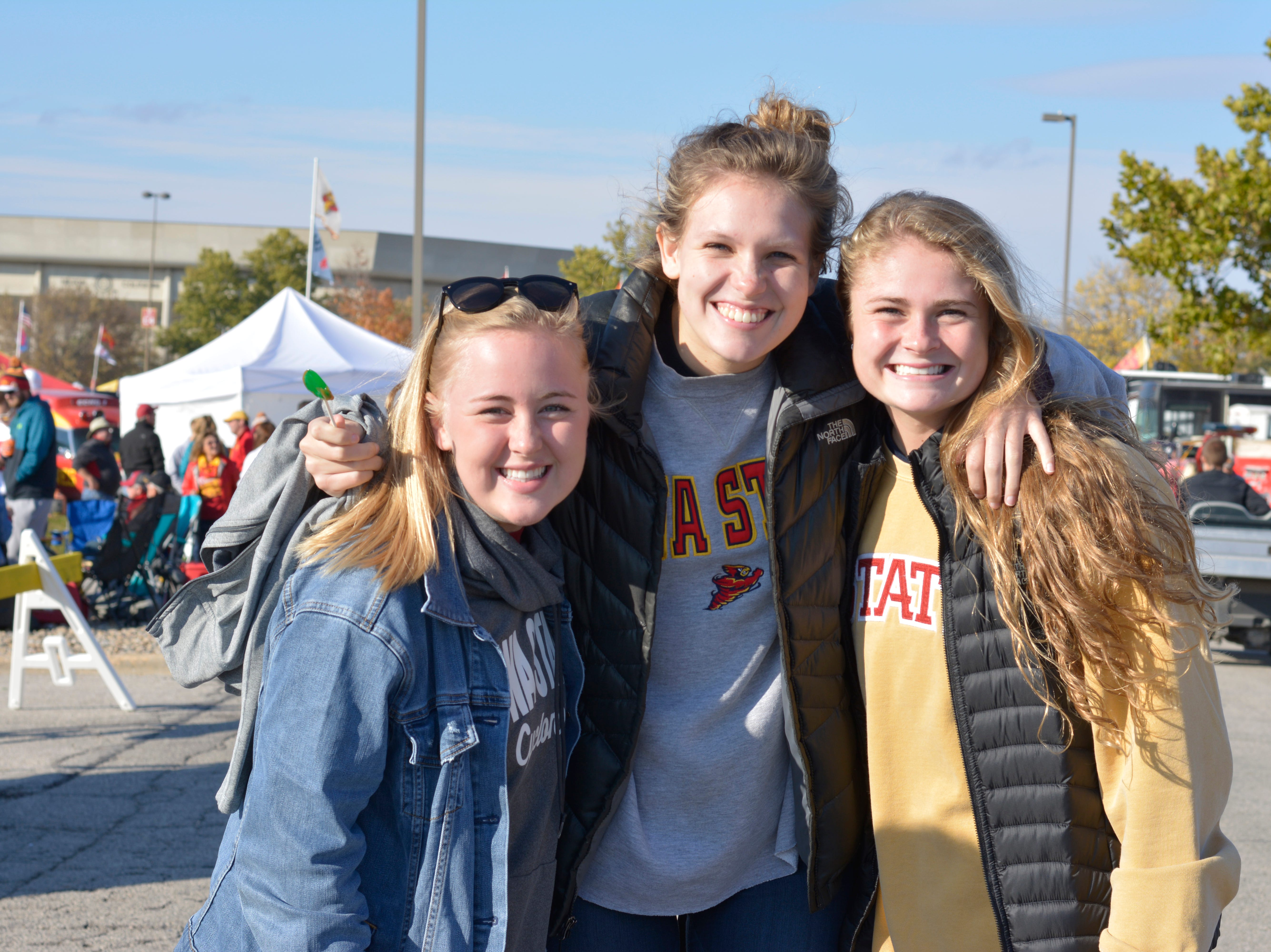 Morgan Weydert (left), Abby Zaugg (middle) and Casie Peyton (right) before the Iowa State University football game against West Virginia in Ames on Oct. 13.