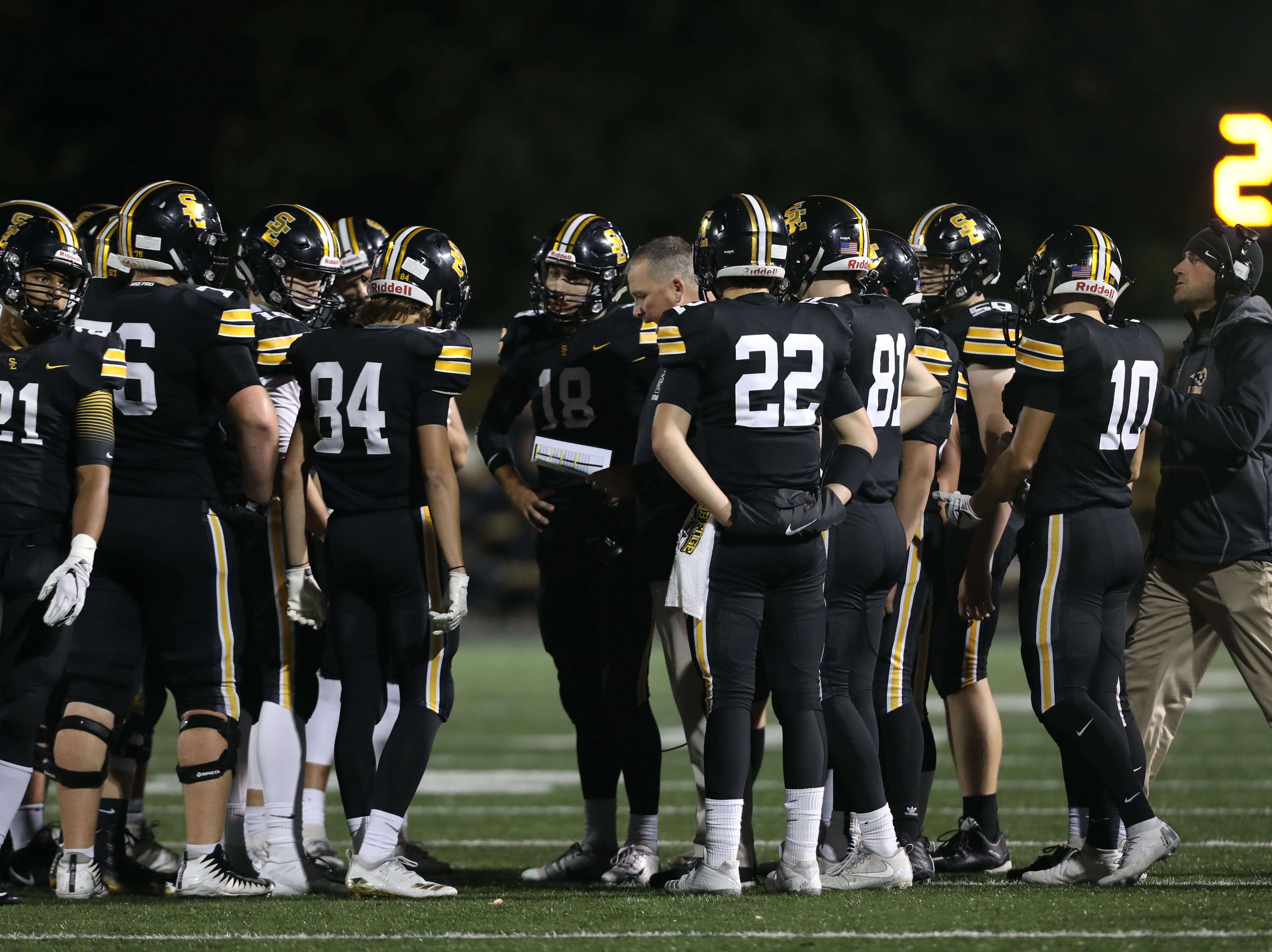 Southeast Polk Rams head coach Brad Zelenovich talks to his Rams during their game wit the Marshalltown Bobcats at SE Polk Stadium. The Rams beat the Bobcats 56 to 7.