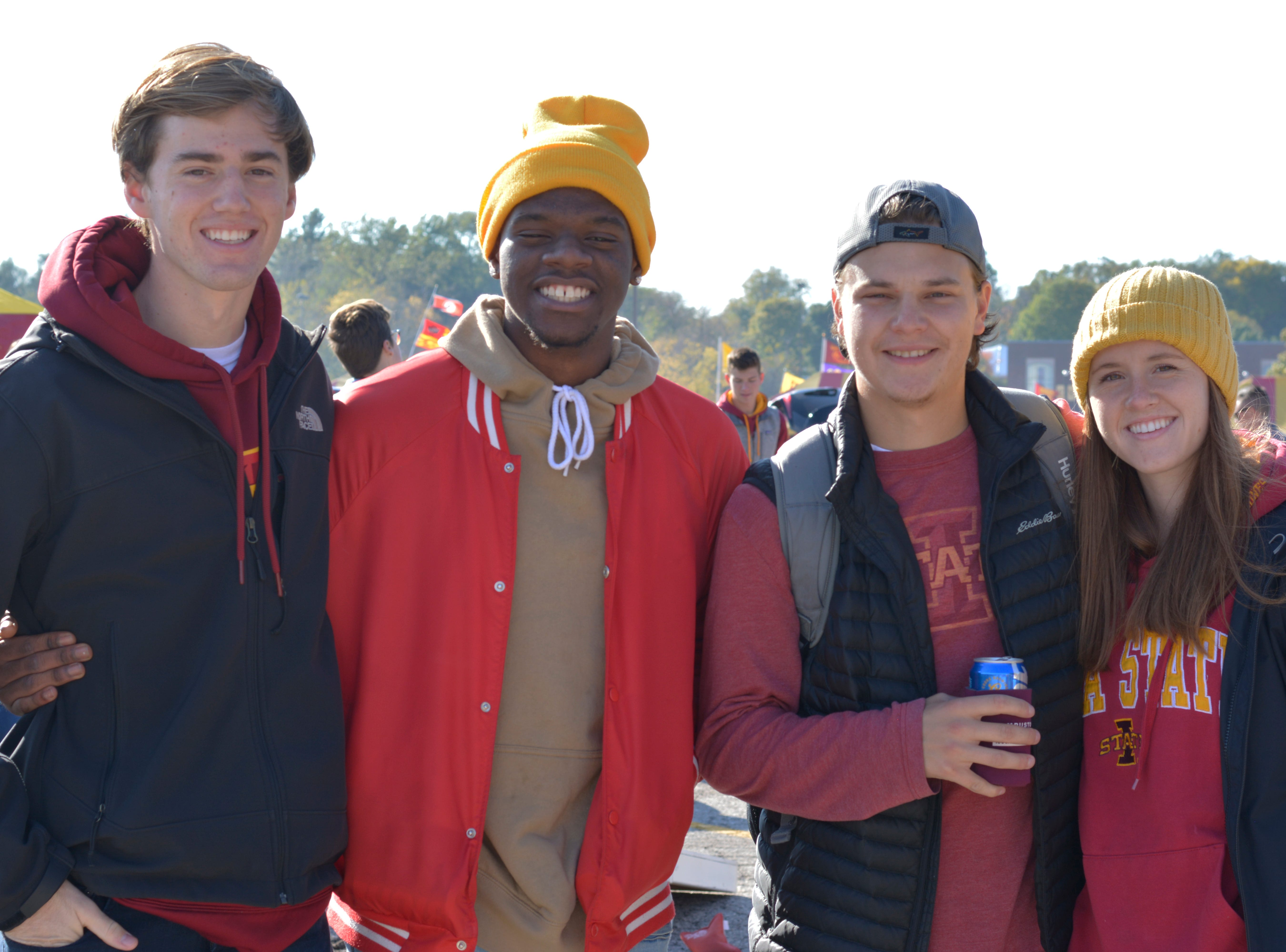 Isaac Buatti, (from left) Scooter Hickman, Jordan Golla and Chelsea Benedict before the Iowa State University football game against West Virginia in Ames on Oct. 13.
