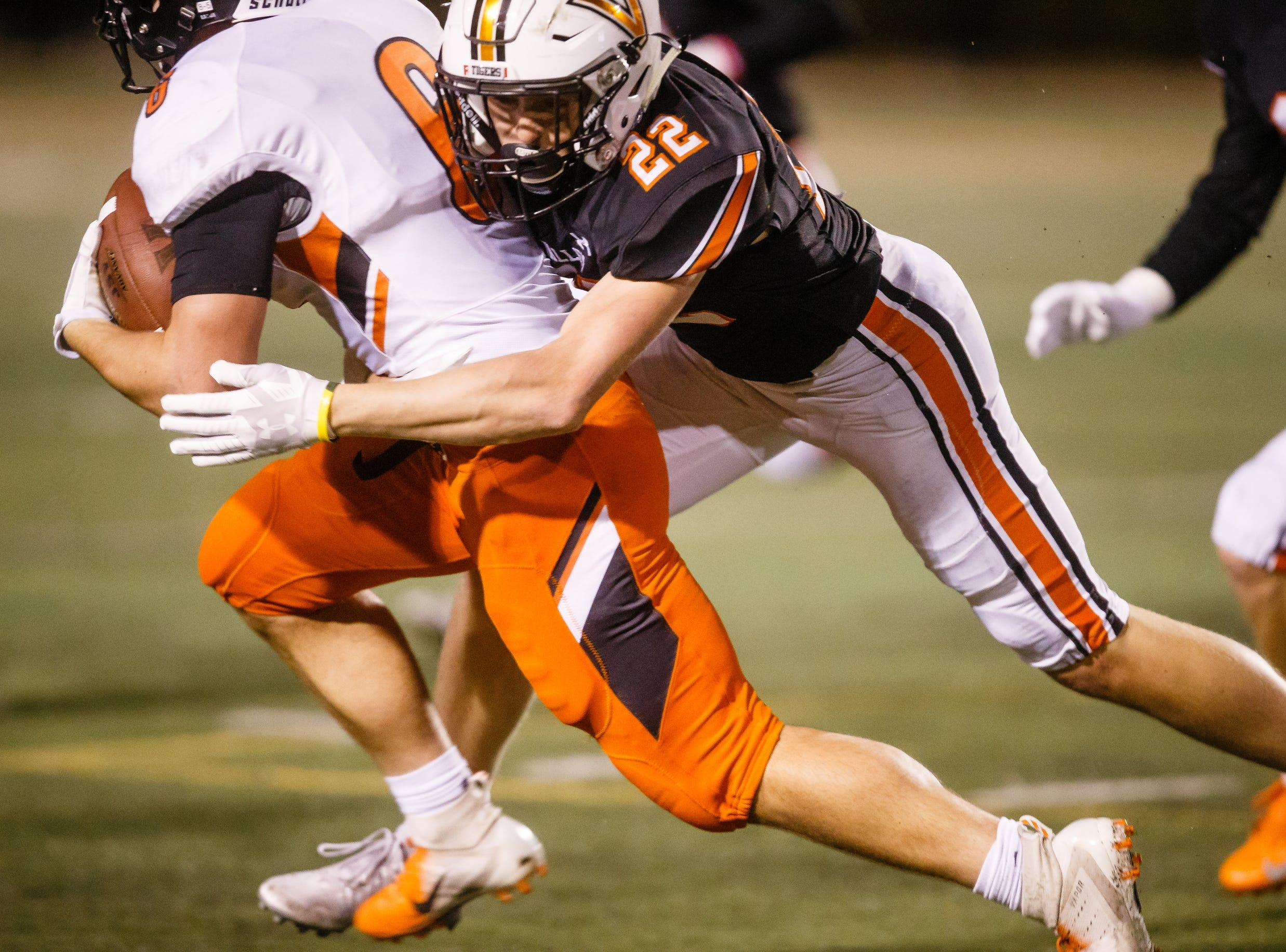 Valley's Jon Shaner (22) tackles Ames' Gabe Ante (6) during their football game at Valley Stadium on Friday, Oct. 12, 2018, in West Des Moines. Valley takes a 31-0 lead into halftime.