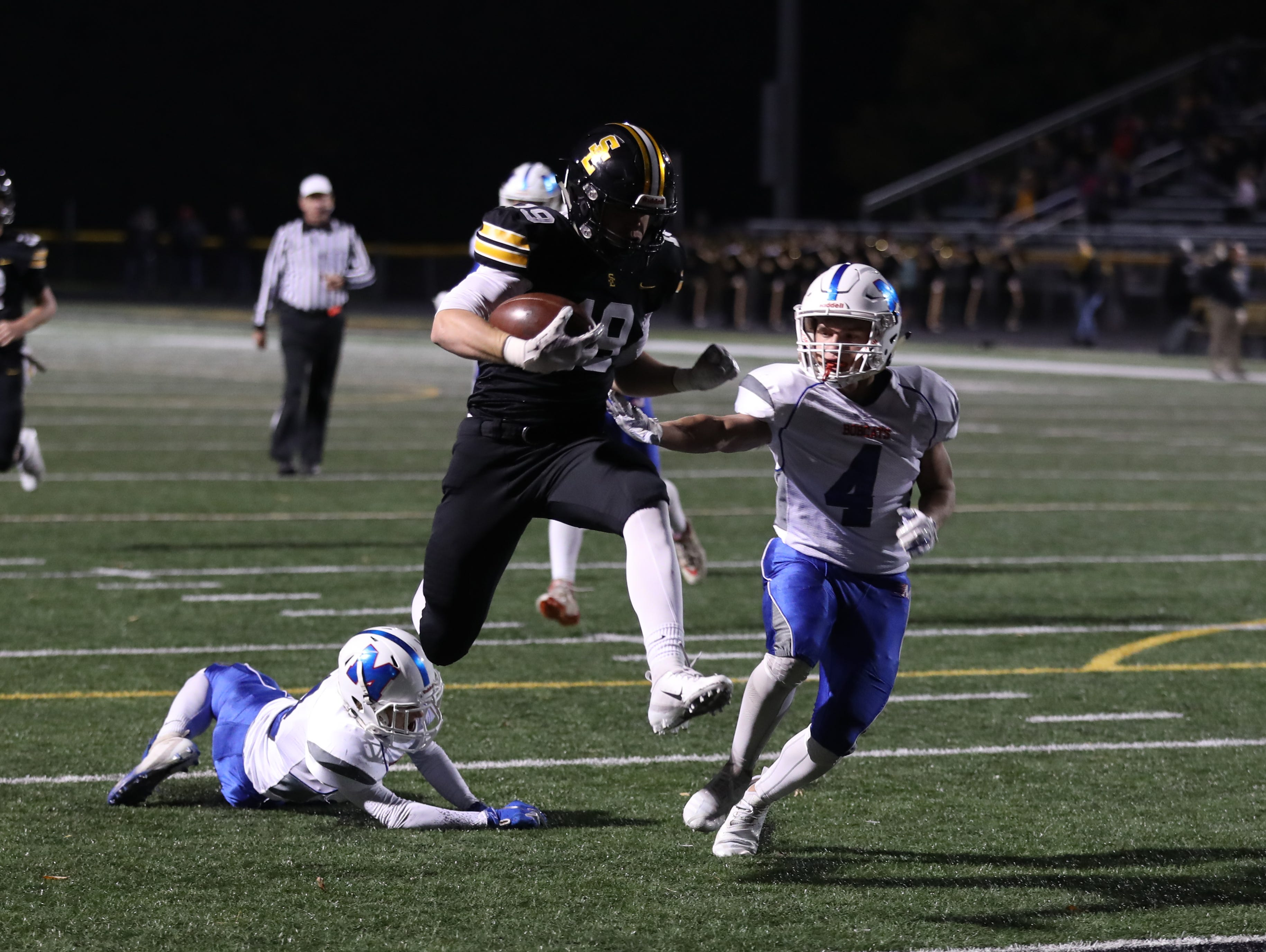 Southeast Polk Rams Jace Christenson (19) jumps into the end zone for a TD against the Marshalltown Bobcats at SE Polk Stadium. The Rams beat the Bobcats 56 to 7.
