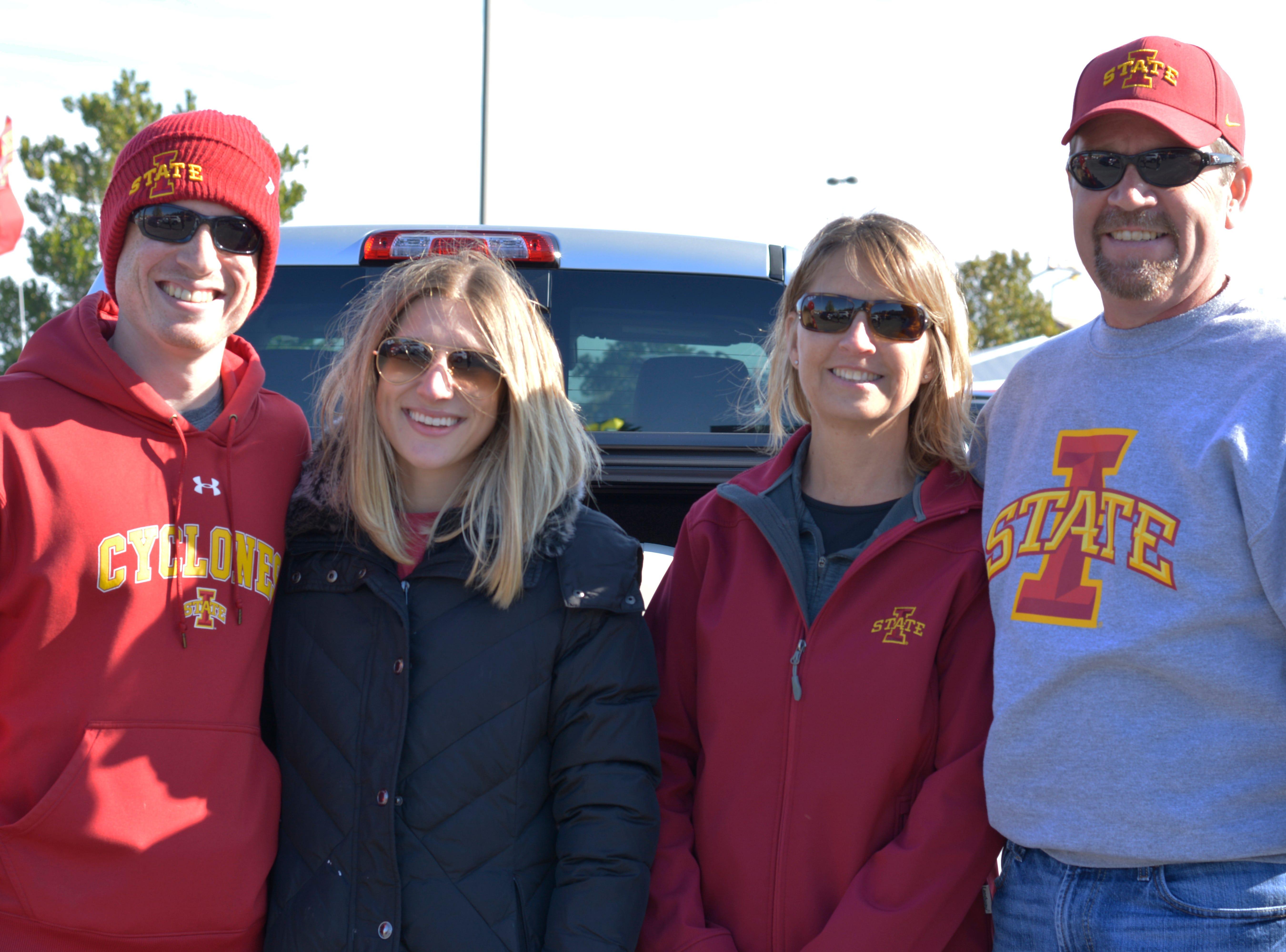 Bill Burtnett, (from left) Sonya Burtnett, Morgan Burtnett and Jeff Burtnett before the Iowa State University football game against West Virginia in Ames on Oct. 13.