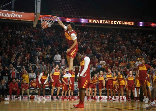 Iowa State's Lindell Wigginton dunks the ball over teammate Cameron Lard during Hilton Madness at Hilton Coliseum in Ames on Friday, Oct. 12, 2018.