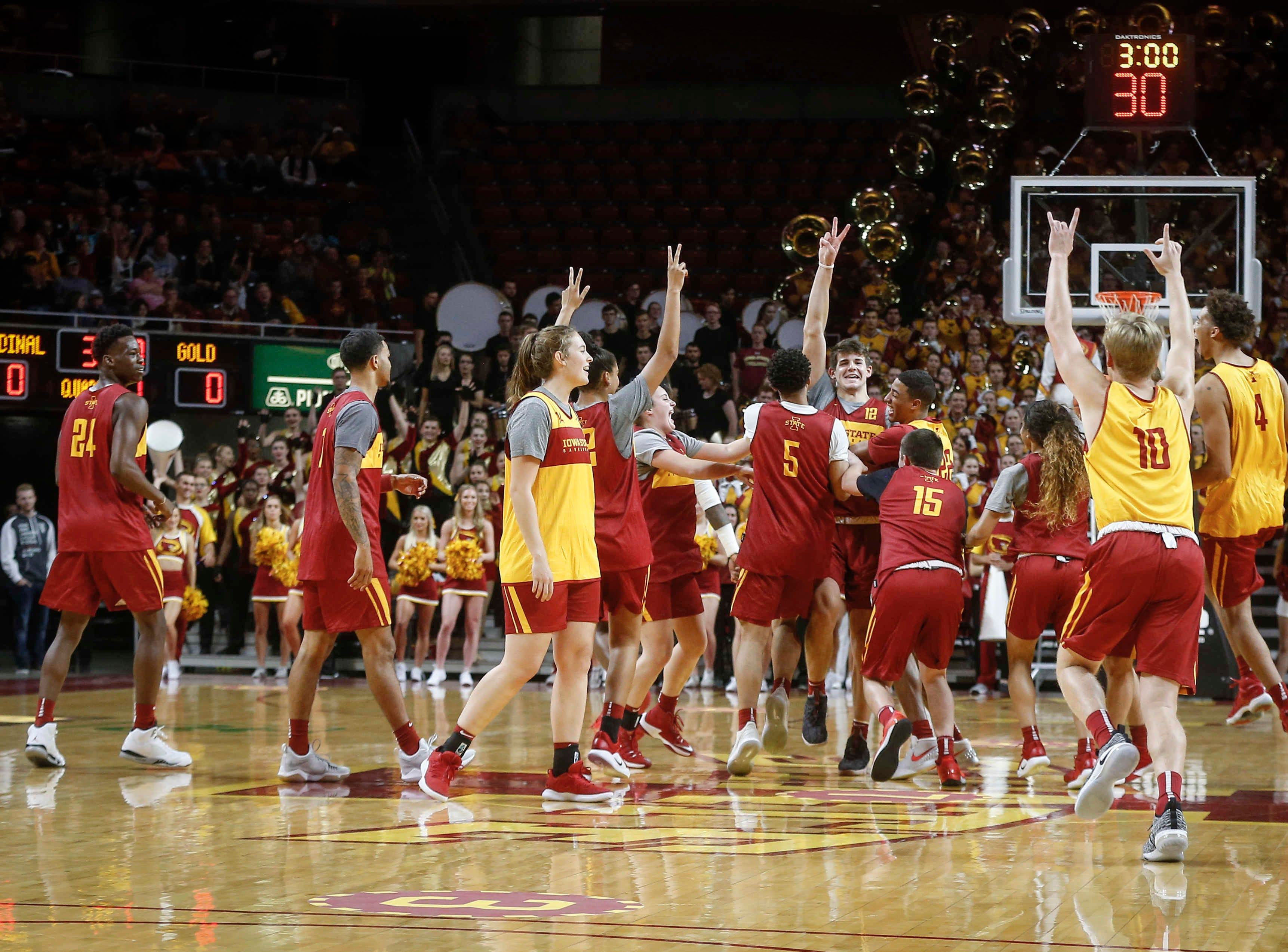 Iowa State players celebrate after the shootout competition during Hilton Madness at Hilton Coliseum in Ames on Friday, Oct. 12, 2018.