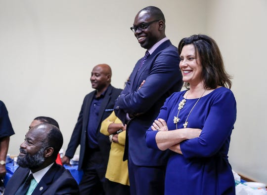 Democratic lieutenant governor candidate Garlin Gilchrist II, center, and governor candidate Gretchen Whitmer smile at the crowd as they were introduced during Fannie Lou Political Action Committee's monthly meeting at the Fellowship Chapel in Detroit, Tuesday, October 9, 2018.