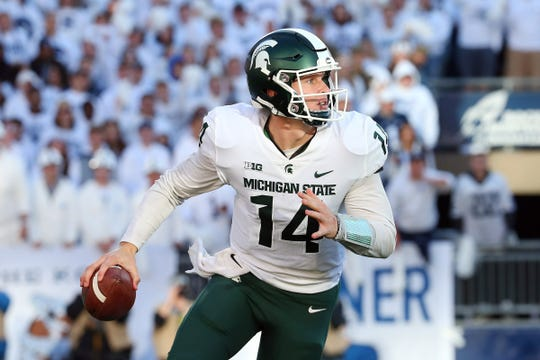 Michigan State quarterback Brian Lewerke runs with the ball against Penn State during the second quarter at Beaver Stadium on Oct. 13, 2018 in State College, Penn.