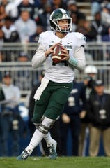 Michigan State quarterback Brian Lewerke drops back in the pocket during the first quarter on Saturday, Oct. 13, 2018, in University Park, Pa.