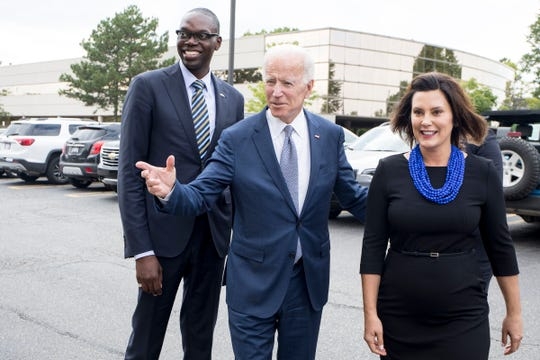 Democratic gubernatorial running mate Garlin Gilchrist, former Vice President Joe Biden and Democratic gubernatorial candidate Gretchen Whitmer arrive at Leo's Coney Island in Southfield on Wednesday, September 12, 2018.