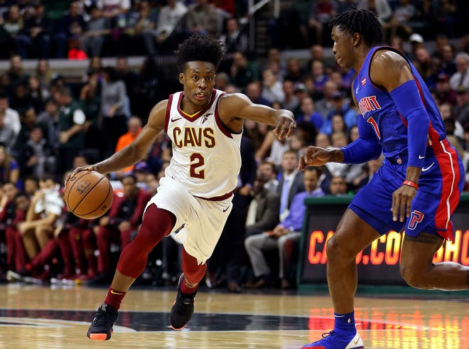 Cavaliers guard Collin Sexton drives to the basket against Pistons forward Stanley Johnson during an exhibition game.