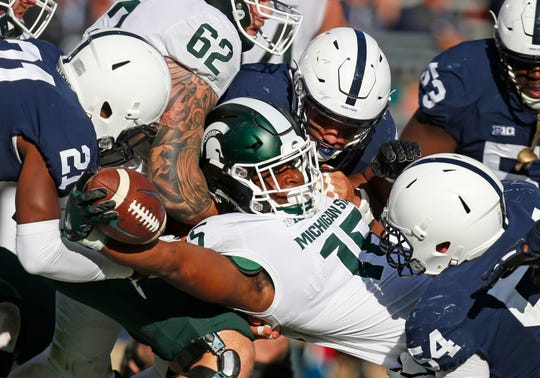 Michigan State's La'Darius Jefferson reaches for a 1-yard touchdown in the first half against Penn State on Oct. 13, 2018 in State College, Penn.