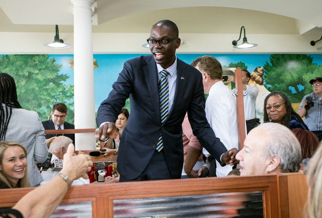 Democratic gubernatorial running mate Garlin Gilchrist stumps for candidate Gretchen Whitmer at Leo's Coney Island in Southfield on Wednesday, September 12, 2018.