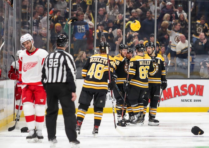 Bruins celebrate after left wing David Pastrnak scores his third goal during the third period of the Wings' 8-2 loss on Saturday, Oct. 13, 2018, in Boston.