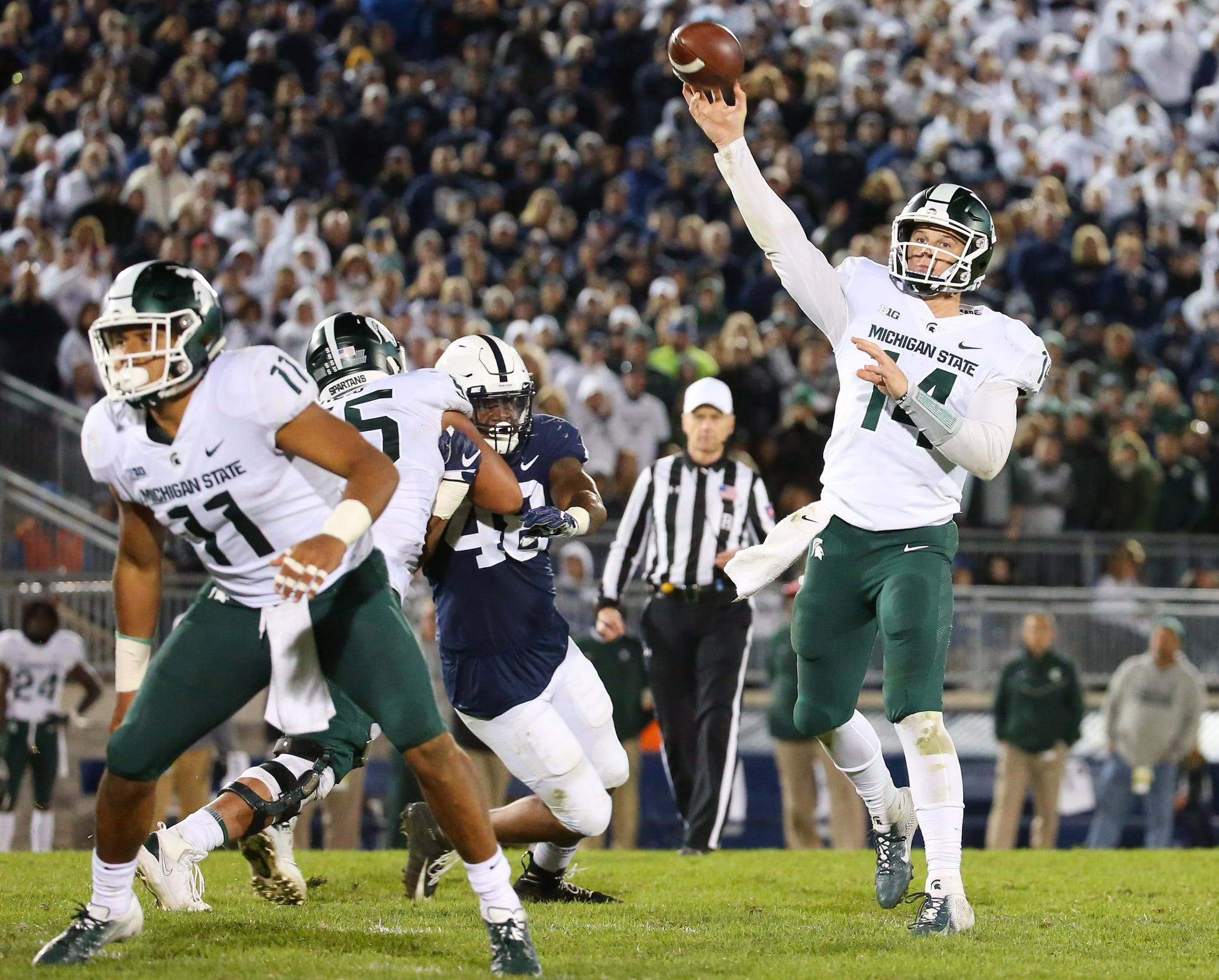 Michigan State quarterback Brian Lewerke passes the ball for the winning touchdown to wide receiver Felton Davis III (not pictured) during the fourth quarter of MSU's 21-17 win on Saturday, Oct. 13, 2018, in University Park, Pa.