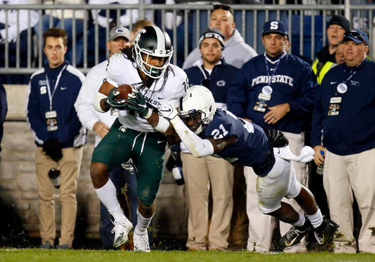 Felton Davis III catches a 25-yard touchdown in the fourth quarter against Penn State's Amani Oruwariye on Oct. 13.
