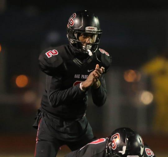 Oak Park's  D'Wan Mathis runs the offense against West Bloomfield on Friday, Oct. 12, 2018 at Oak Park High School.