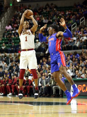 Oct. 12, 2018, East Lansing: Cleveland Cavaliers guard Rodney Hood attempts a 3-pointer over Detroit Pistons forward Stanley Johnson during the first quarter at Breslin Center.