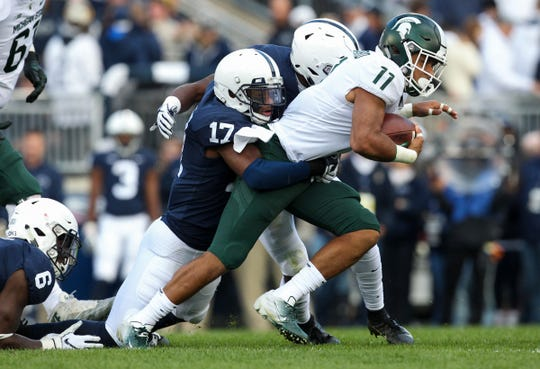 Michigan State running back Connor Heyward runs with the ball during the first quarter on Saturday, Oct. 13, 2018, in University Park, Pa.
