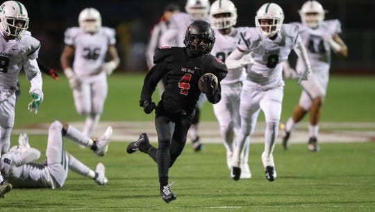 Oak Park's Phillip Stewart runs the ball against West Bloomfield on Friday, Oct. 12, 2018 at Oak Park High School.