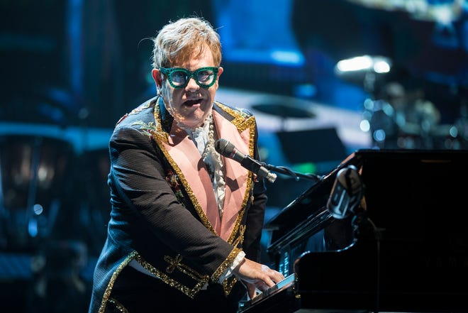 Elton John performs Bennie and the Jets during his Farewell Yellow Brick Road concert at the Little Caesars Arena in Detroit, Friday, October 12, 2018.